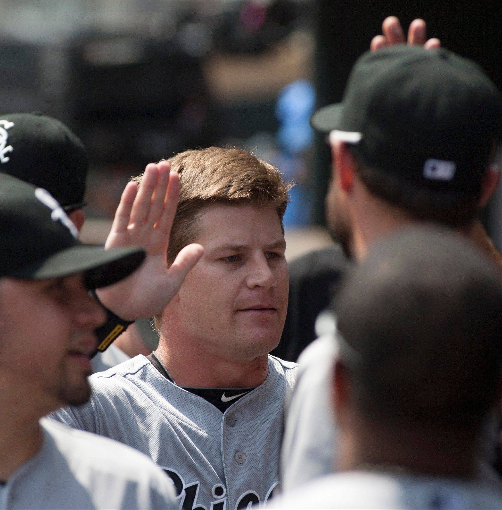 White Sox Gordon Beckham, center, is congratulated by teammates after scoring from second on an Alexei Ramirez single during the first inning of a baseball game against the Minnesota Twins, Sunday, Aug. 18, 2013, in Minneapolis.