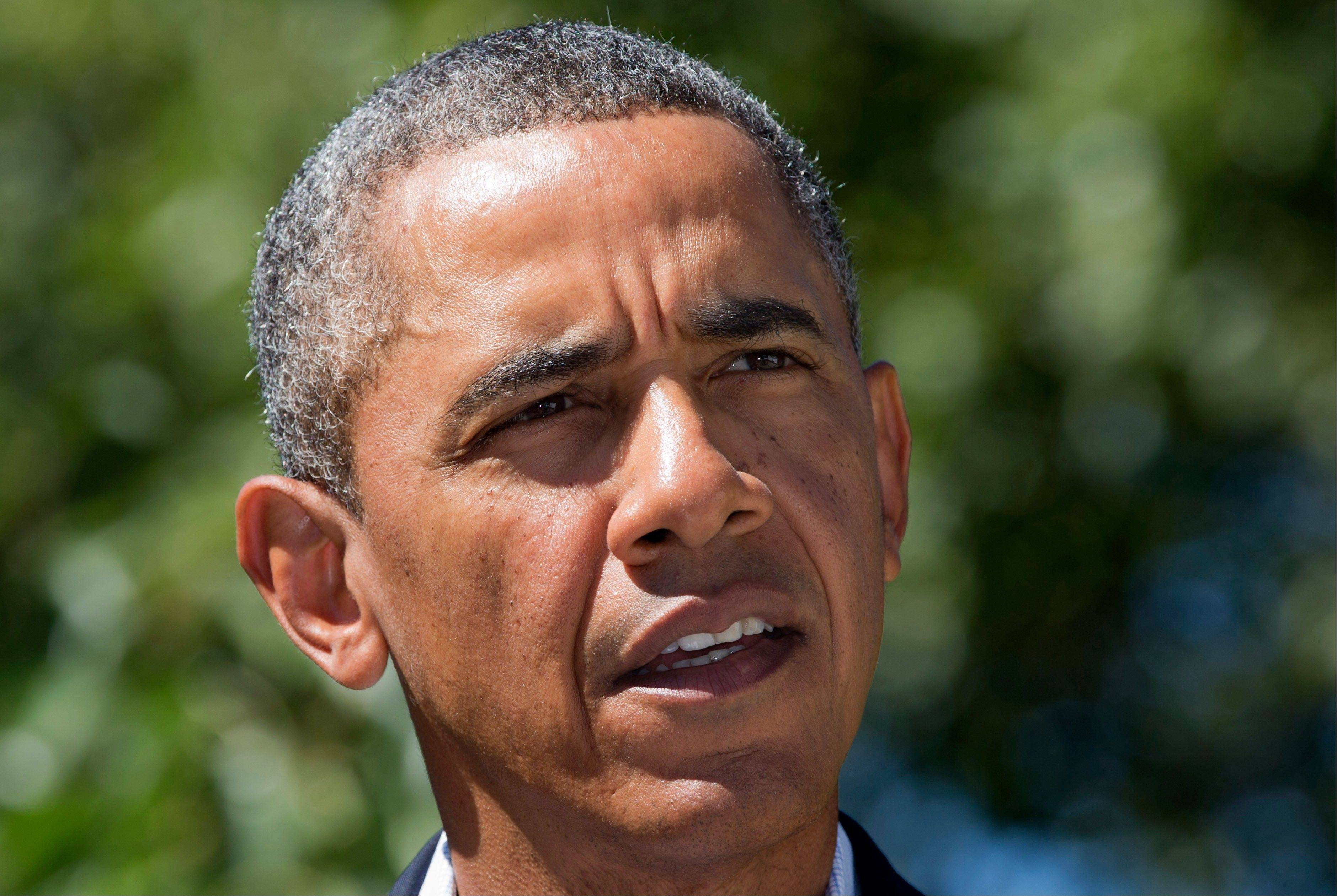 President Barack Obama makes a statement to the media regarding events in Egypt, from his rental vacation home in Chilmark Mass., on the island of Martha's Vineyard, Thursday, Aug. 15, 2013. The president announced that the US is canceling joint military exercise with Egypt amid violence.