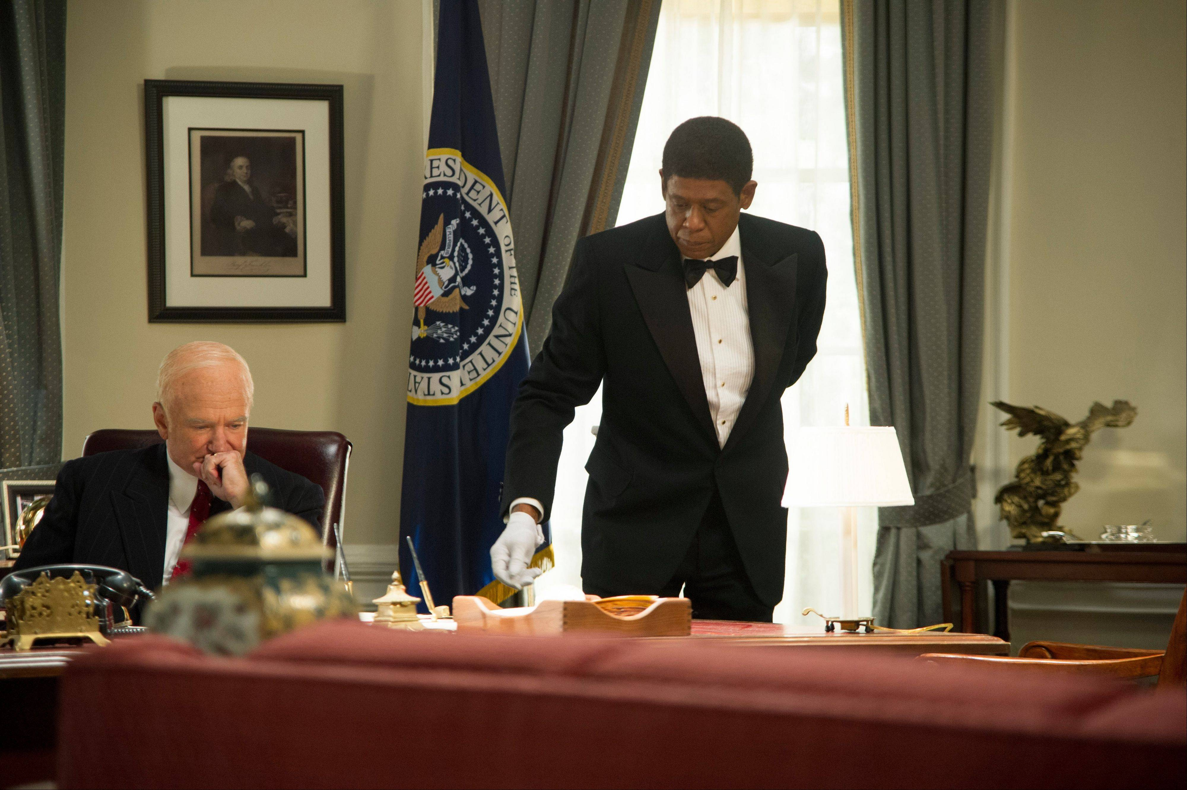 "This film image released by The Weinstein Co. shows Robin Williams as Dwight Eisenhower, left, and Forest Whitaker as Cecil Gaines in a scene from ""Lee Daniels' The Butler."" The film, also starring Oprah Winfrey, came in No. 1 at the box office with $25 million."