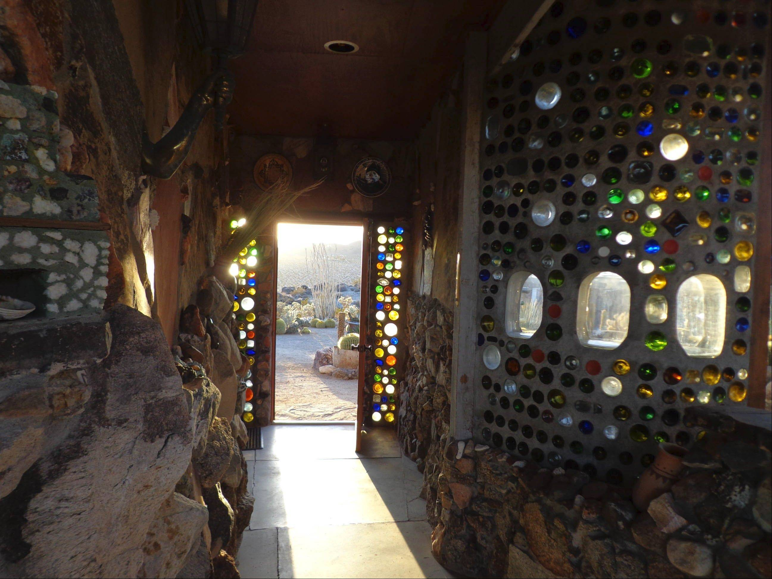 The bottles facing the west wall light up on cue at sunset every day.