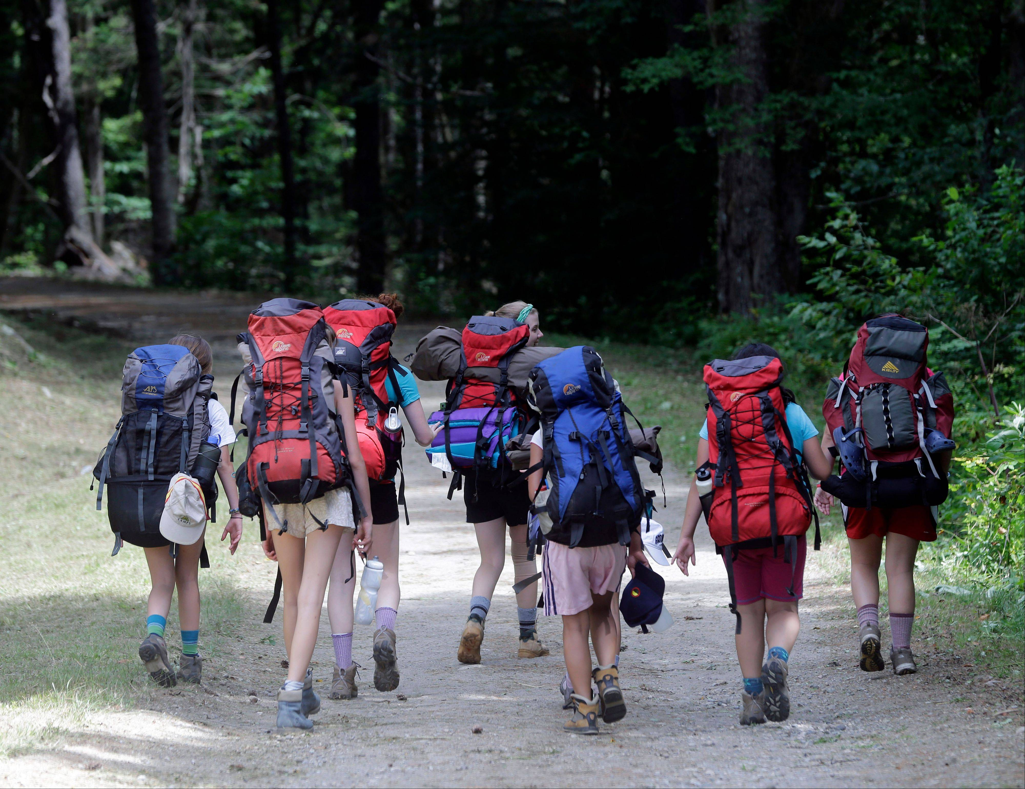 Campers from North Country Camps in Keeseville, N.Y., hike the road to Camp Santanoni.