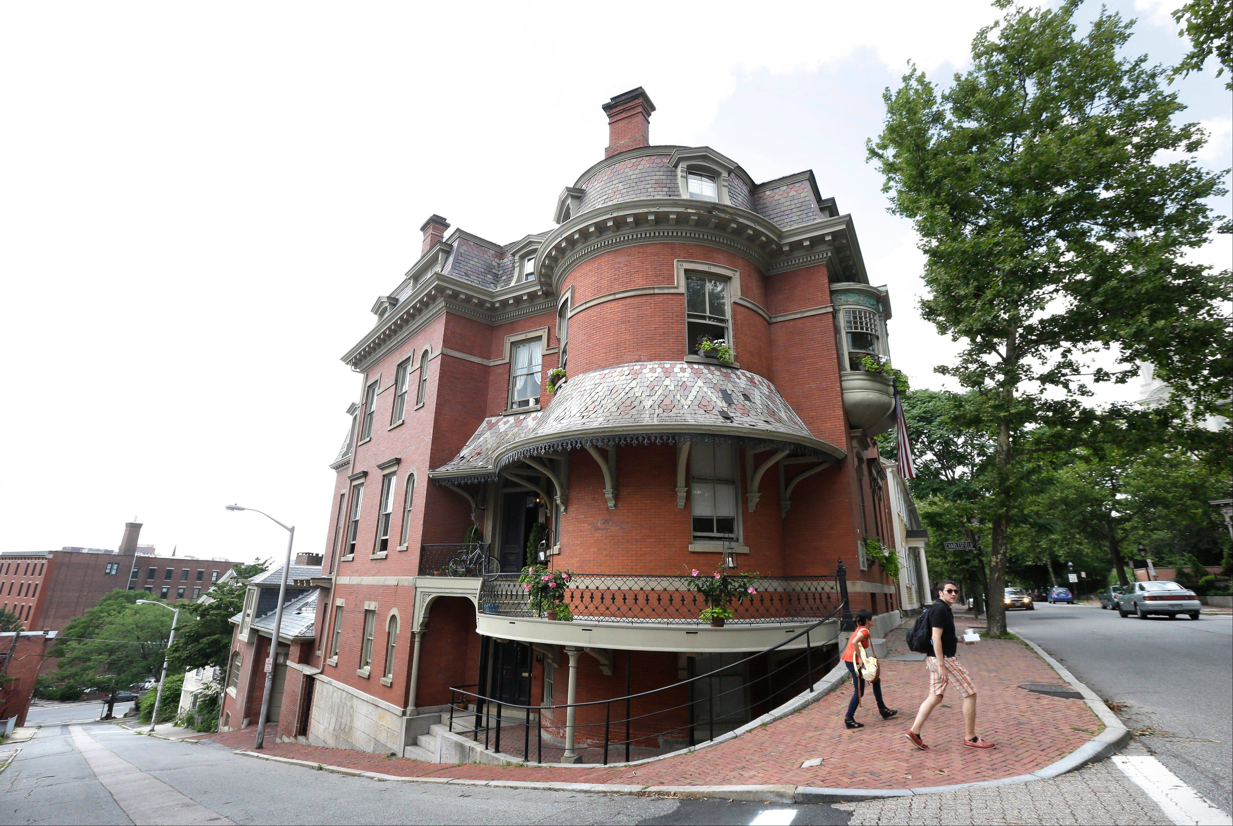 People walk past the Gen. Ambrose Burnside House at the corner of Benefit and Planet streets, in Providence. A walk down Benefit Street is one of a number of free attractions in Rhode Island.