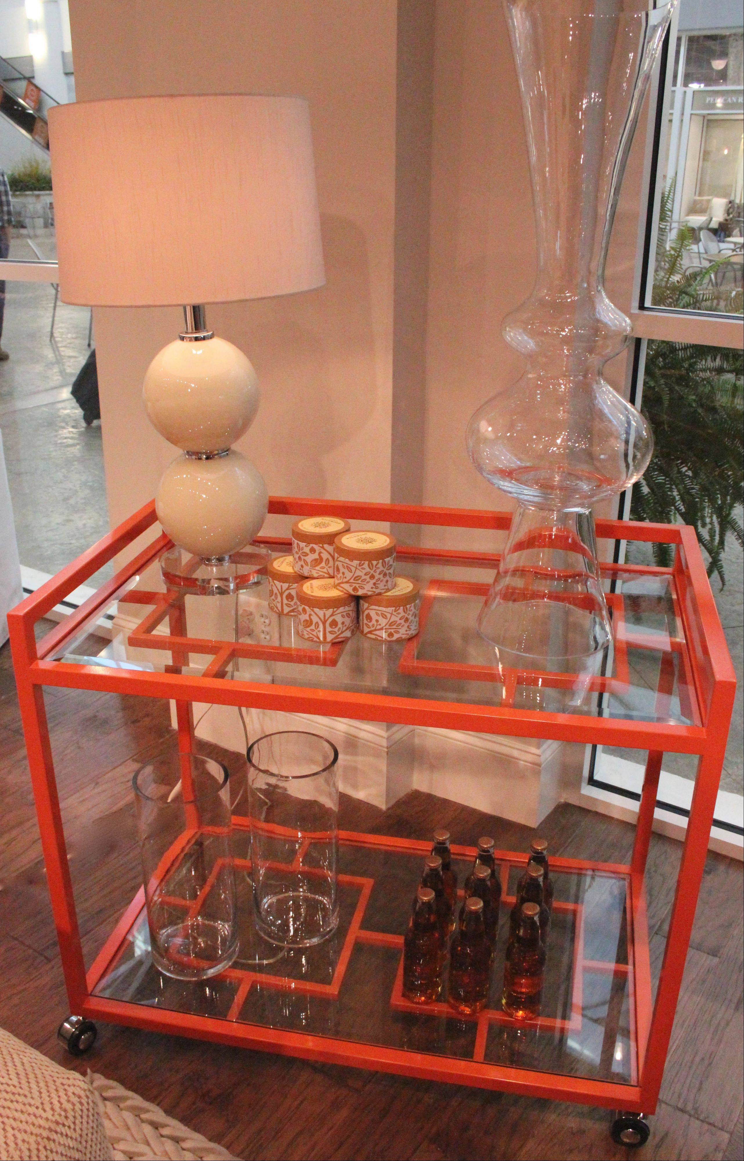 Rowe Furniture brought its orange lacquer bar cart to the Spring Furniture Market, a prominent home decor show in North Carolina.