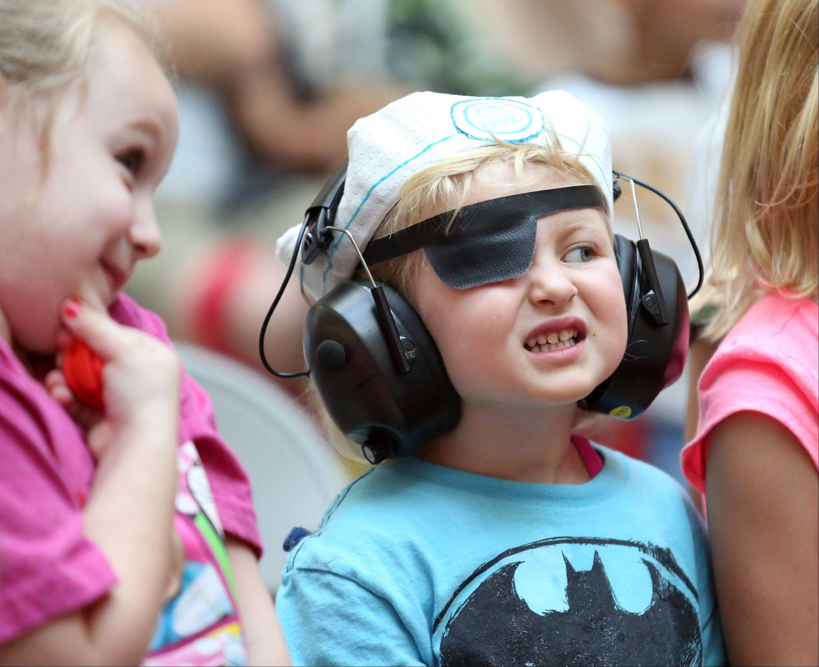 Four-year-old Lexi Alt, of Lake Zurich, wore a sailor cap and eye patch to match characters on the show Octonauts, but wore head phones to protect her ears from screams of excitement by over 100 children watching The Octonauts' Captain Barnacles and Kwazii Kitten from the hit Disney children's television series, performing at Westfield Hawthorn Mall in Vernon Hills on Friday.