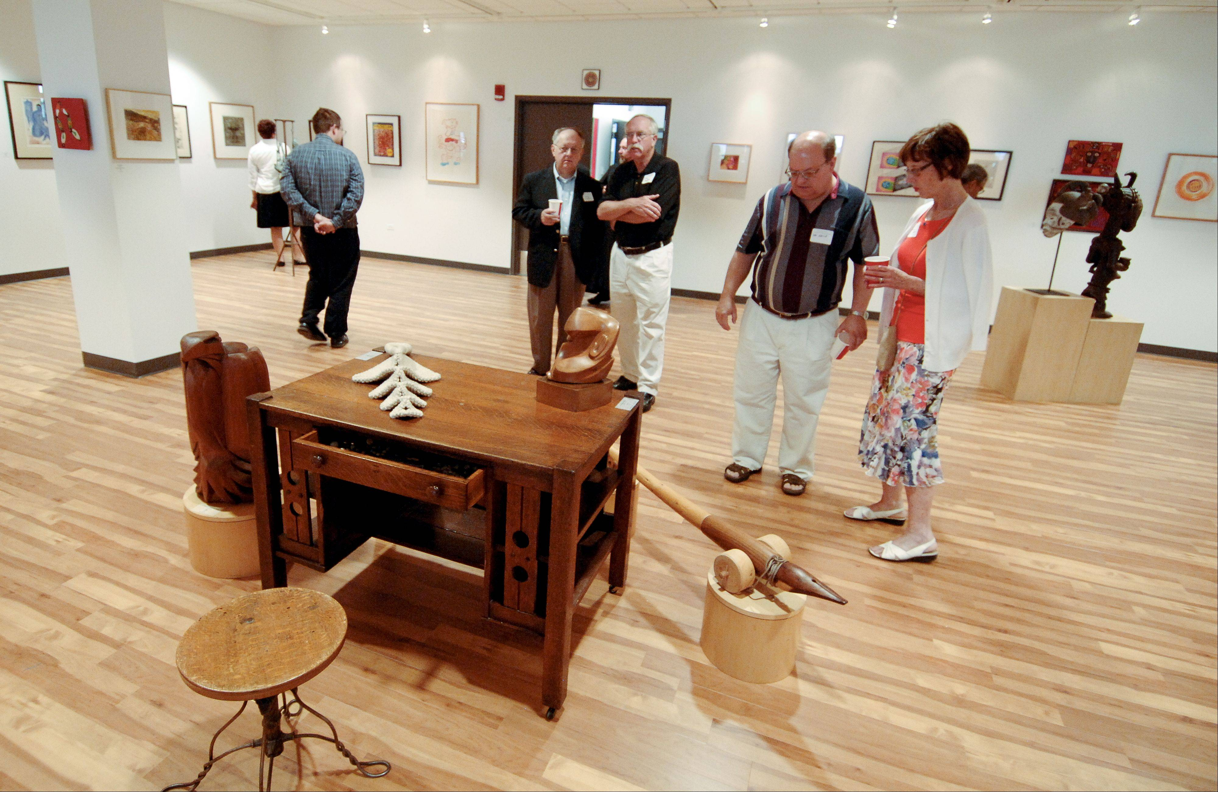 Benedictine University officials on Sunday dedicated the new Fr. Michael E. Komechak Art Gallery in Kindlon Hall of Learning on the school's Lisle campus. Komechak was a passionate supporter of the arts.