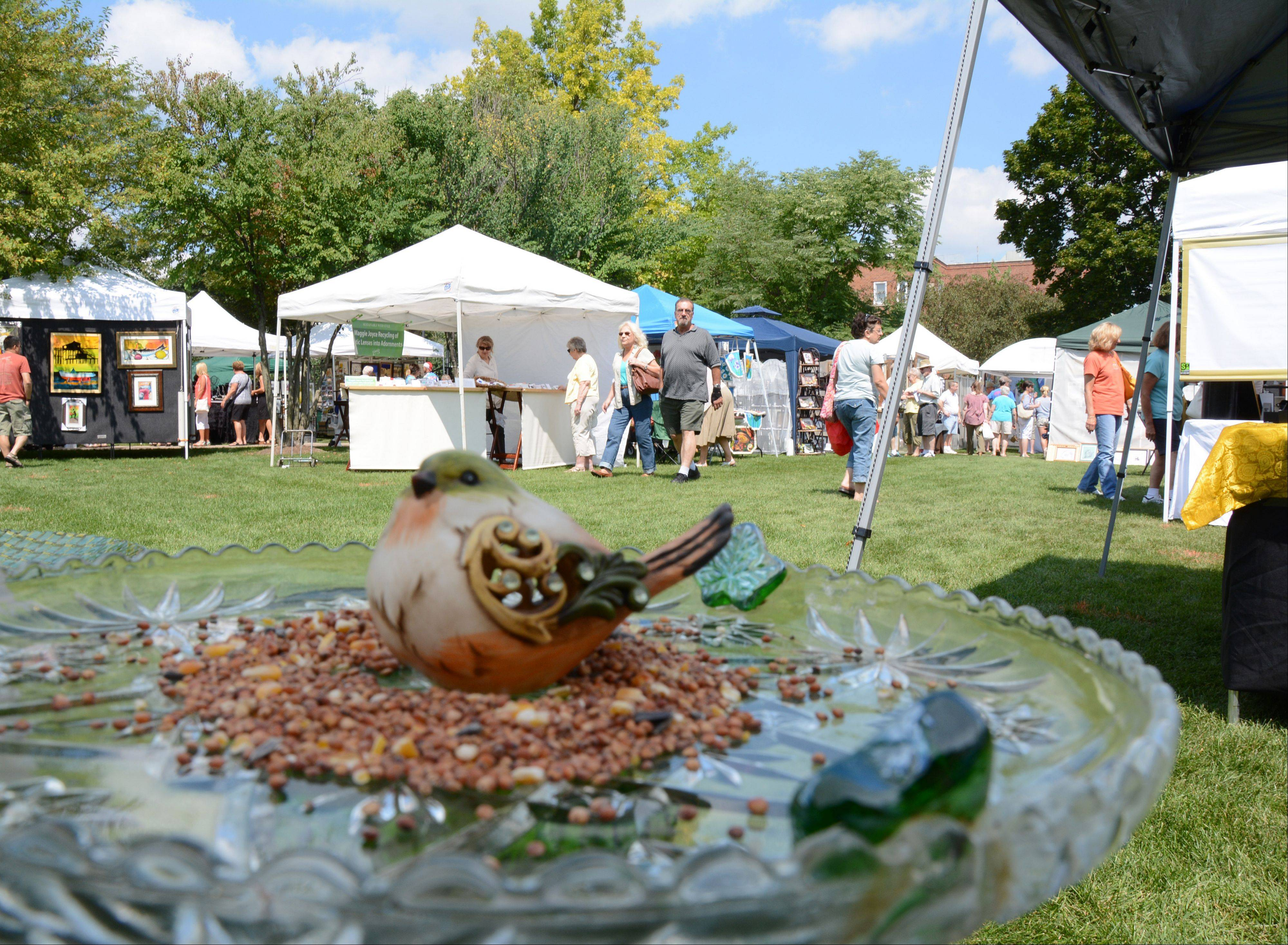 A birdbath made from recycled and repurposed glass was among the items on display at artist Pamela Pence's booth during the annual A Walk in the Park art fair Arlington Heights Sunday.
