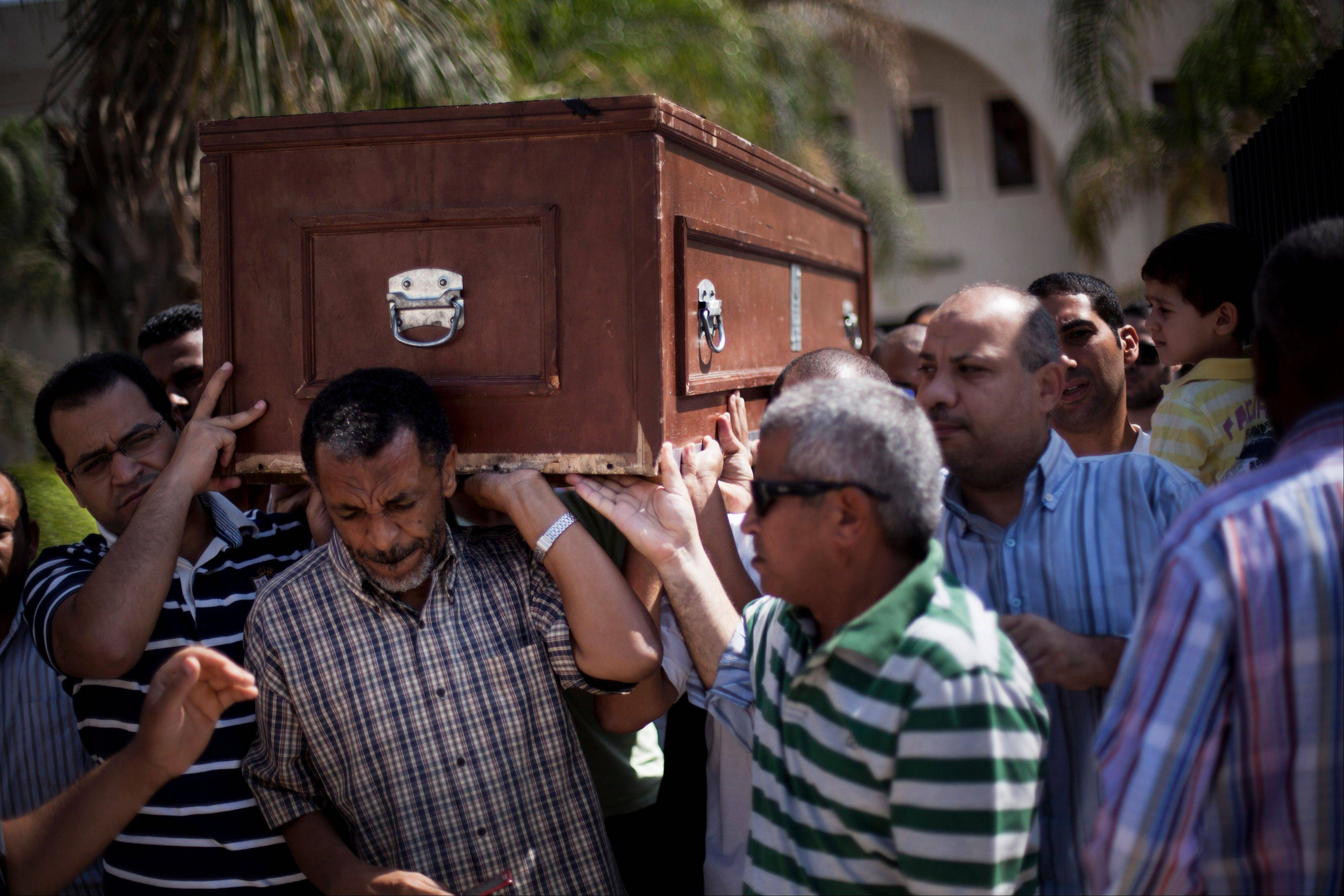 Friends and relatives of Ammar Badie, 38, killed Friday by Egyptian security forces during clashes in Ramses Square, and also son of Muslim Brotherhood's spiritual leader Mohammed Badie, carry his coffin during his funeral in al-Hamed mosque in Cairo's Katameya district, Egypt, Sunday.