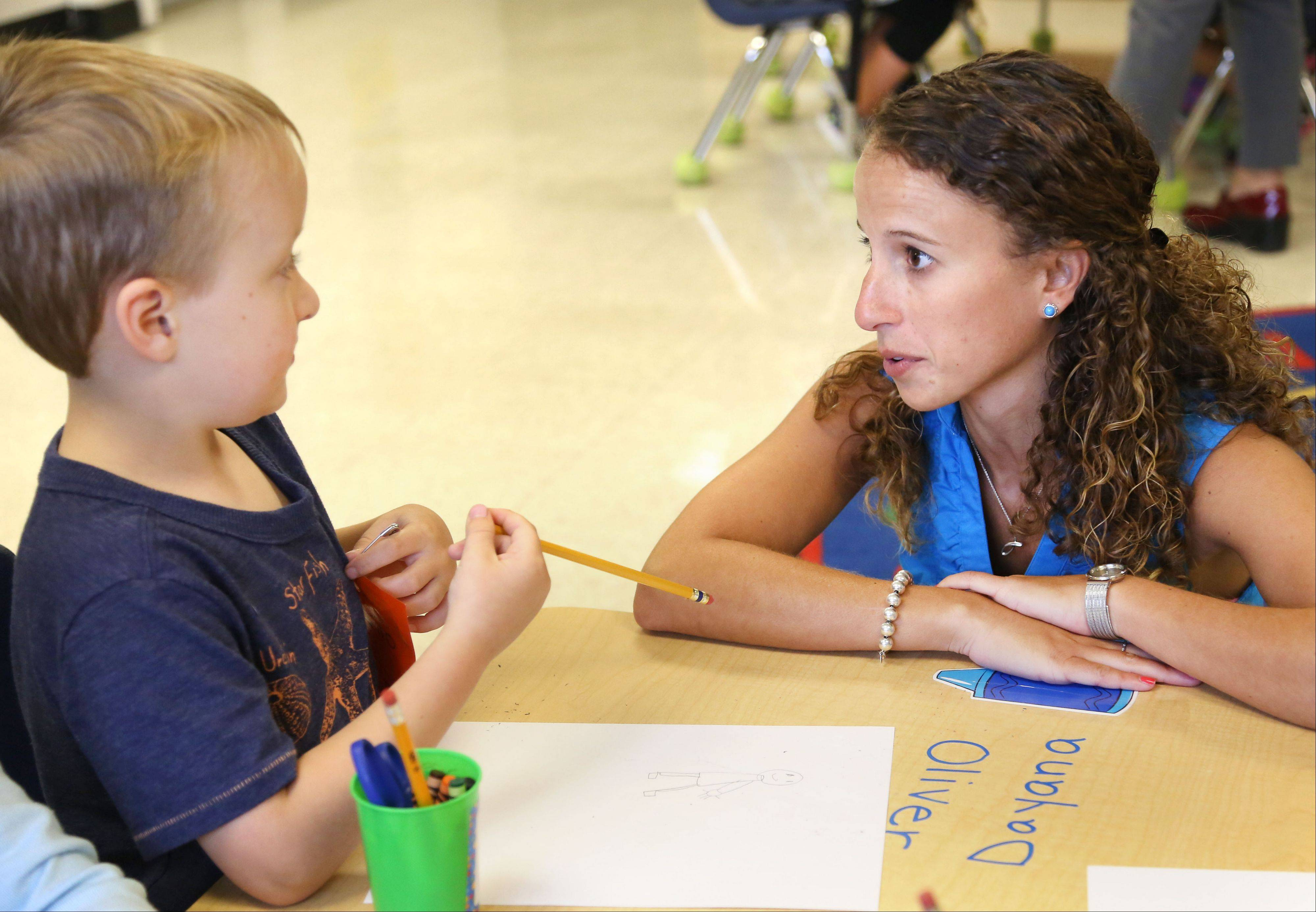 Kindergarten teacher Julie Silverberg works with Oliver Van de Motter at Washington Elementary School in Mundelein. Silverberg and teachers throughout the suburbs are implementing the new Common Core State Standards by teaching kids how to be more critical thinkers.