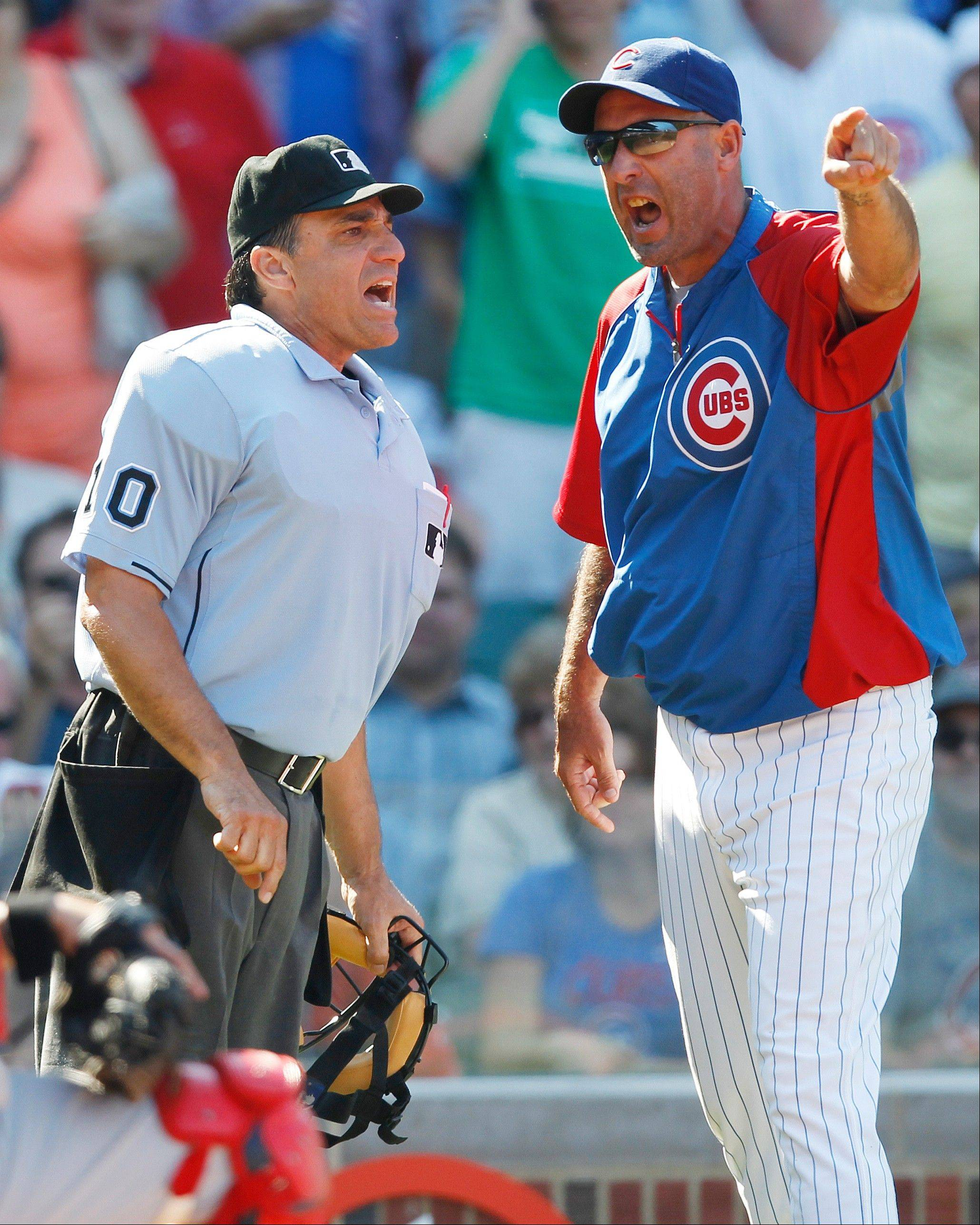 Cubs manager Dale Sveum argues with plate umpire Phil Cuzzi after the Cubs' Donnie Murphy was called out on a checked swing in the seventh inning. Sveum was ejected from the game.