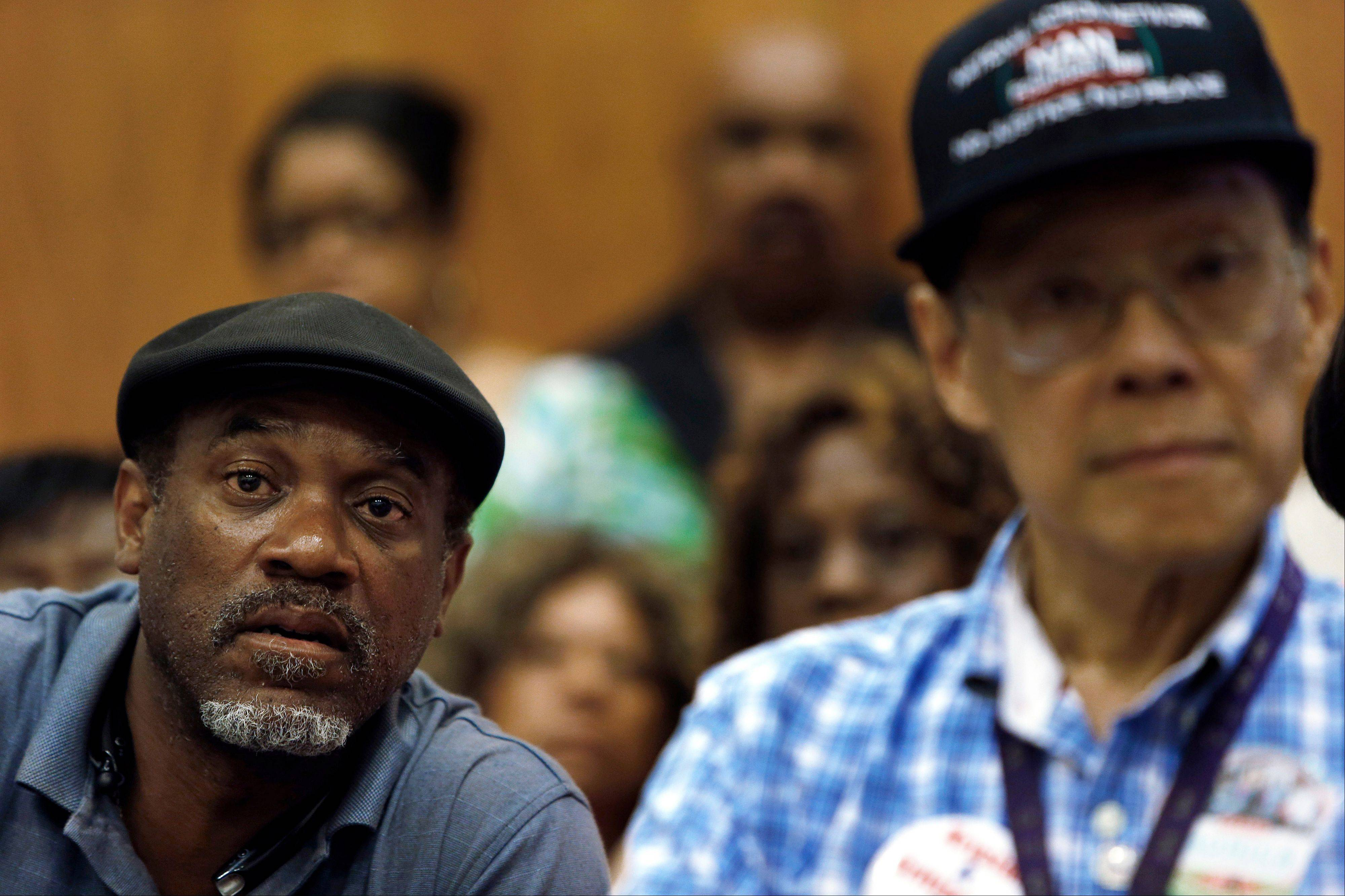 Tony Brown, left, a Department of Transportation retiree, listens to union leaders talk about what Detroit�s bankruptcy filing means to thousands of retirees during a meeting in Detroit. Monday is the deadline for a host of banks, bond insurers, two employee pension systems and others standing to lose big if a federal judge declares Detroit insolvent to legally file their objections to the largest municipal bankruptcy in U.S. history.
