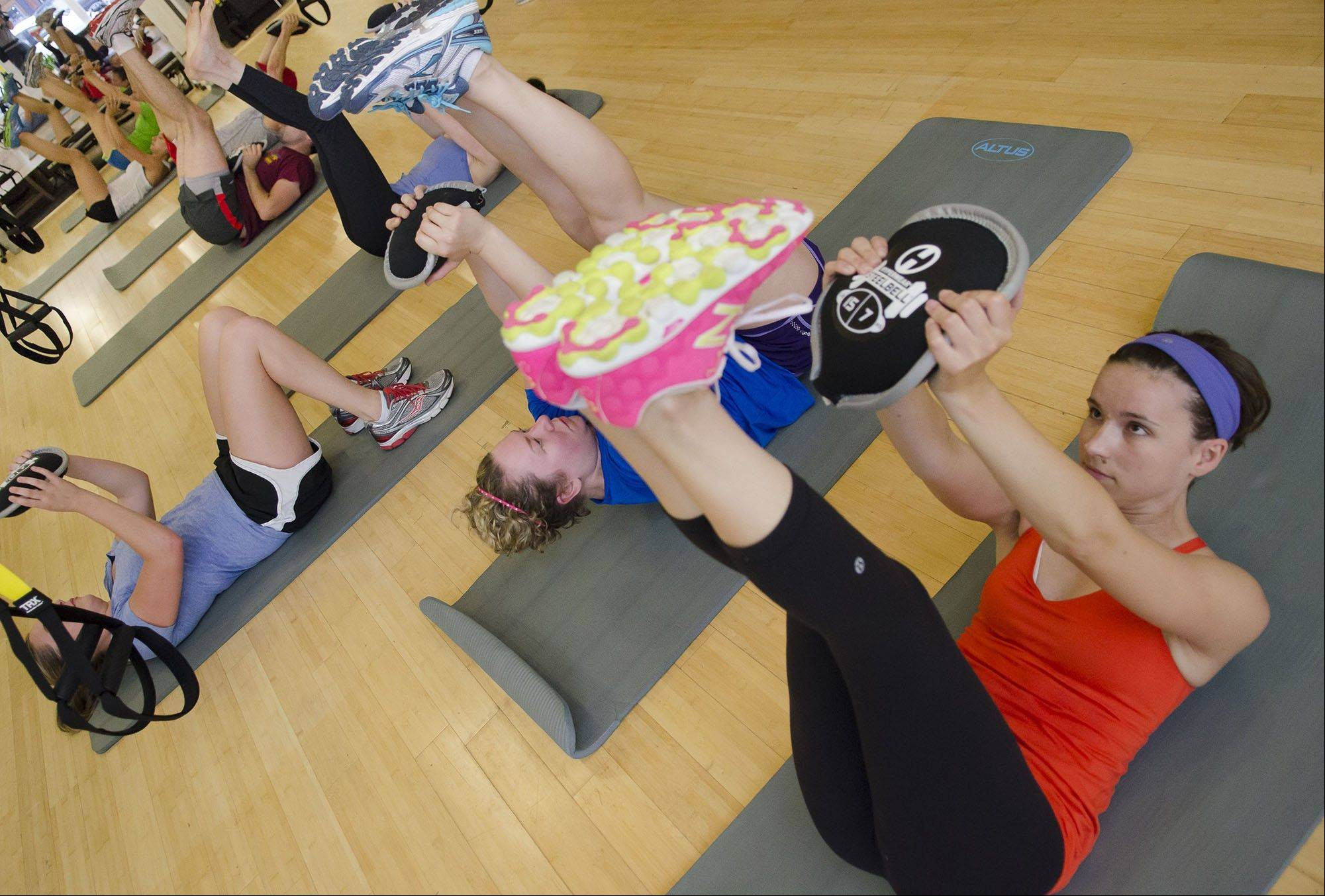 Versatile weights known as SteelBells, neoprene discs stuffed with steel shot, are turning gym goers into disc jockeys.