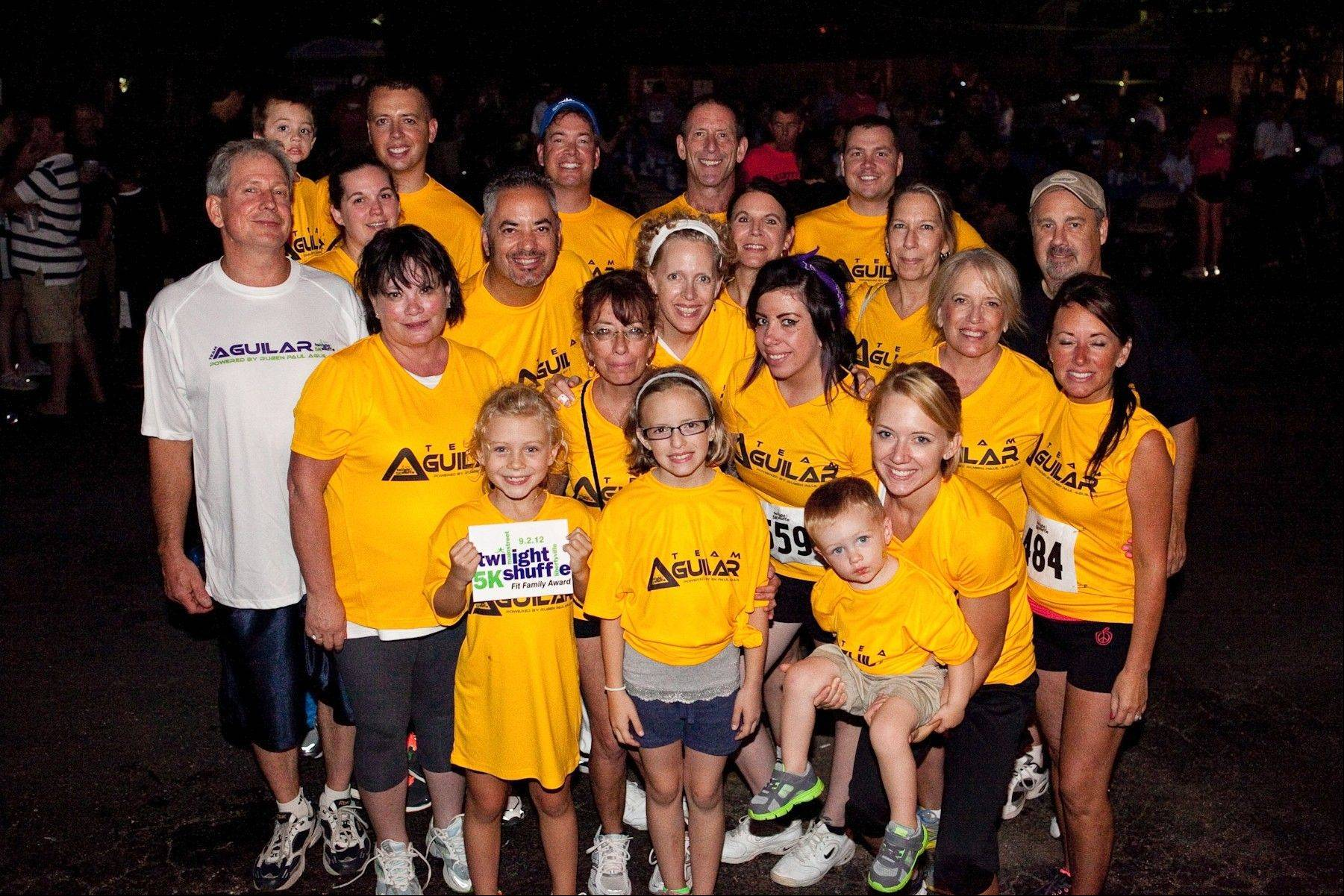 2012 Fit Family Award winners the Aguilar family at last year�s MainStreet Libertyville Twilight Shuffle 5K.