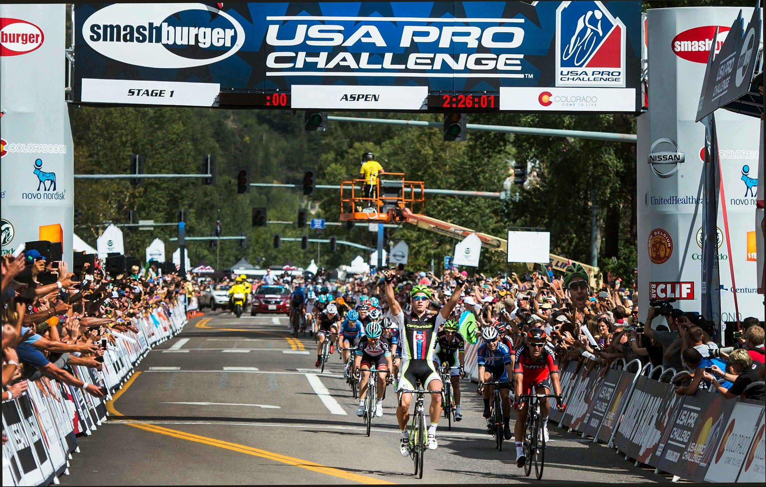 Peter Sagan of Team Cannondale crosses the finish line first in Monday�s opening stage of the USA Pro Challenge in Aspen, Colo.