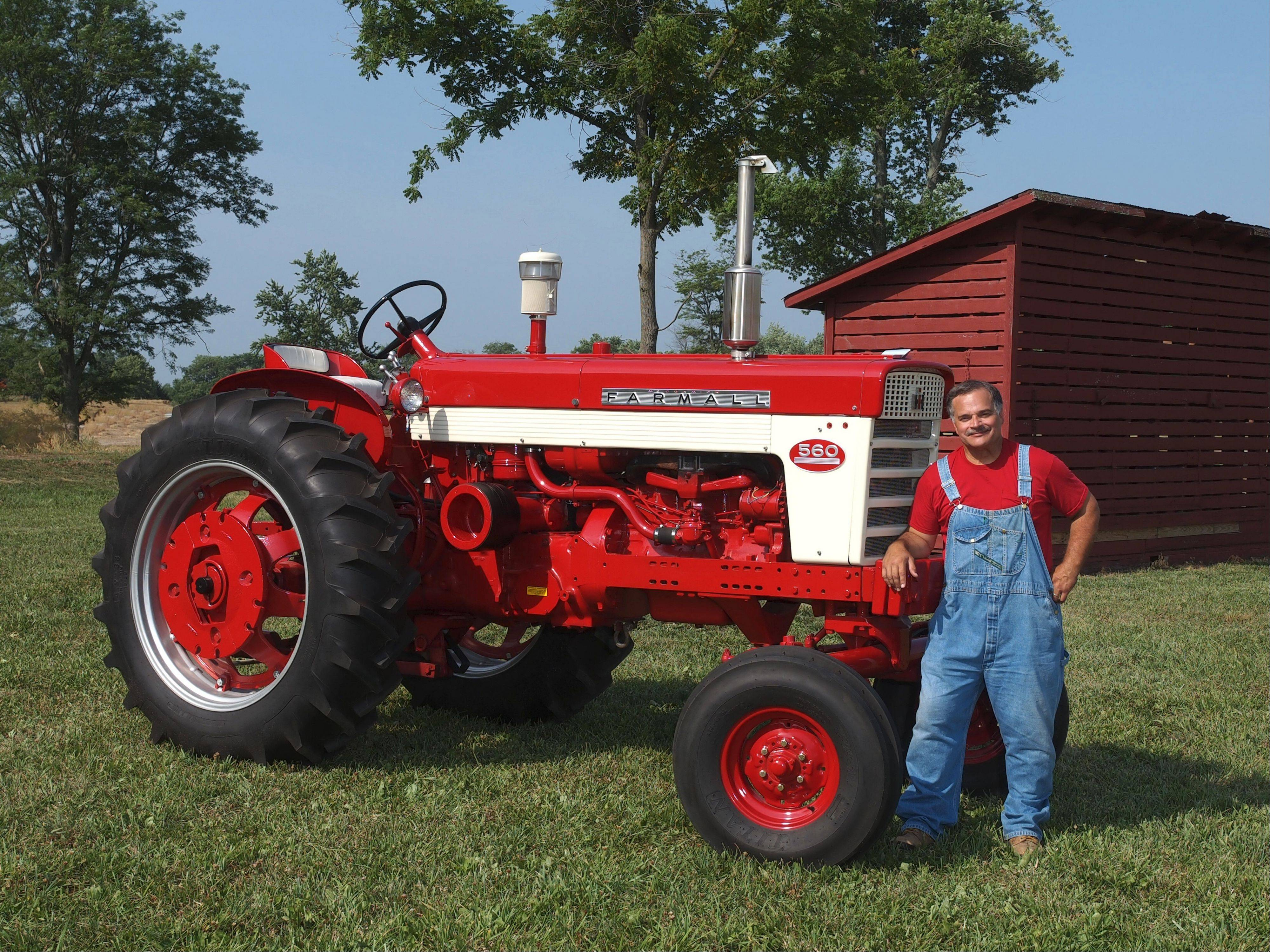 Max Armstrong of Naperville, longtime agricultural broadcaster on WGN Radio and on satellite TV, stands in front of his Farmall 560 tractor made in 1962 by International Harvester.