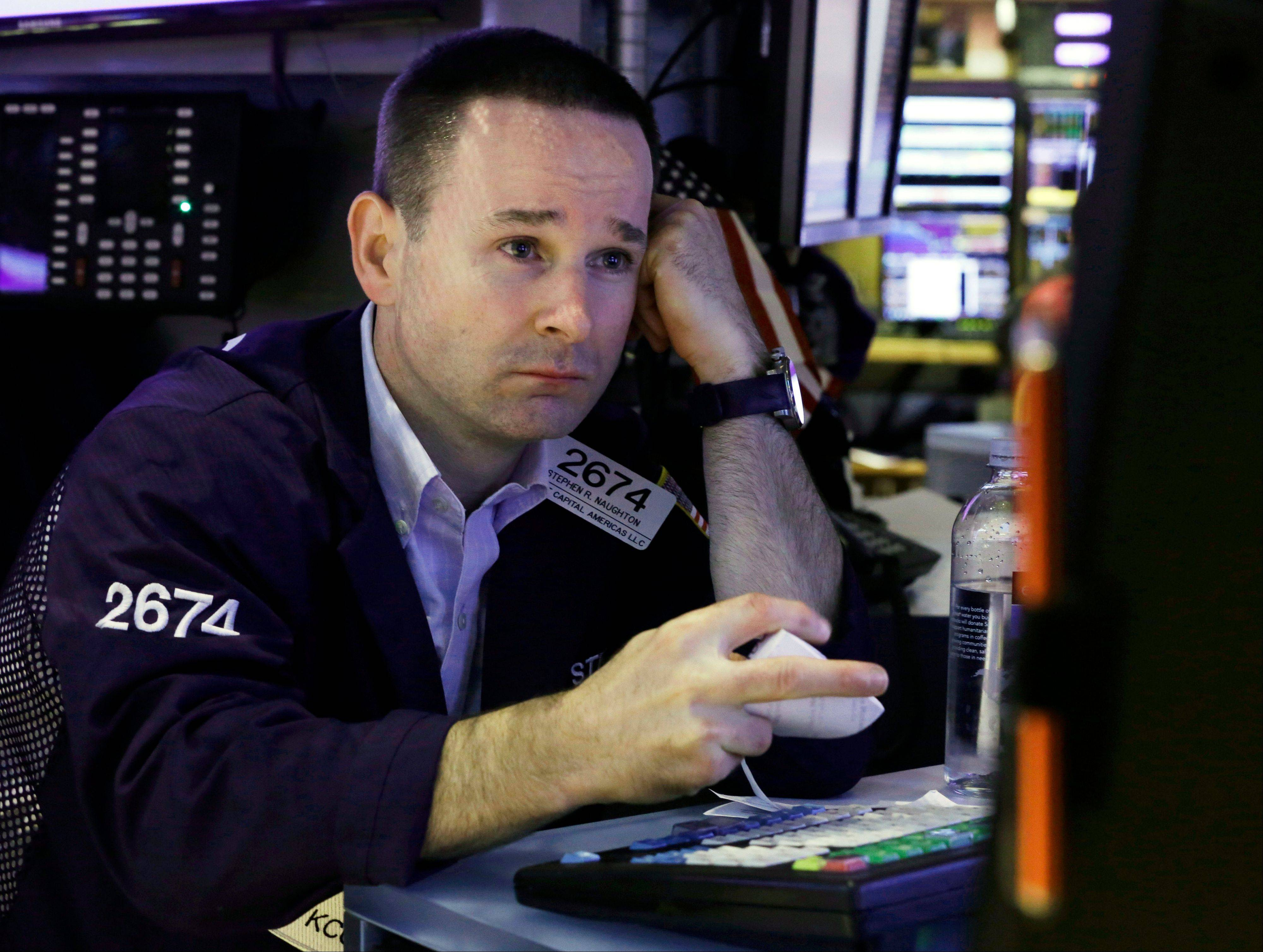 Specialist Stephen Naughton works at his post on the floor of the New York Stock Exchange.
