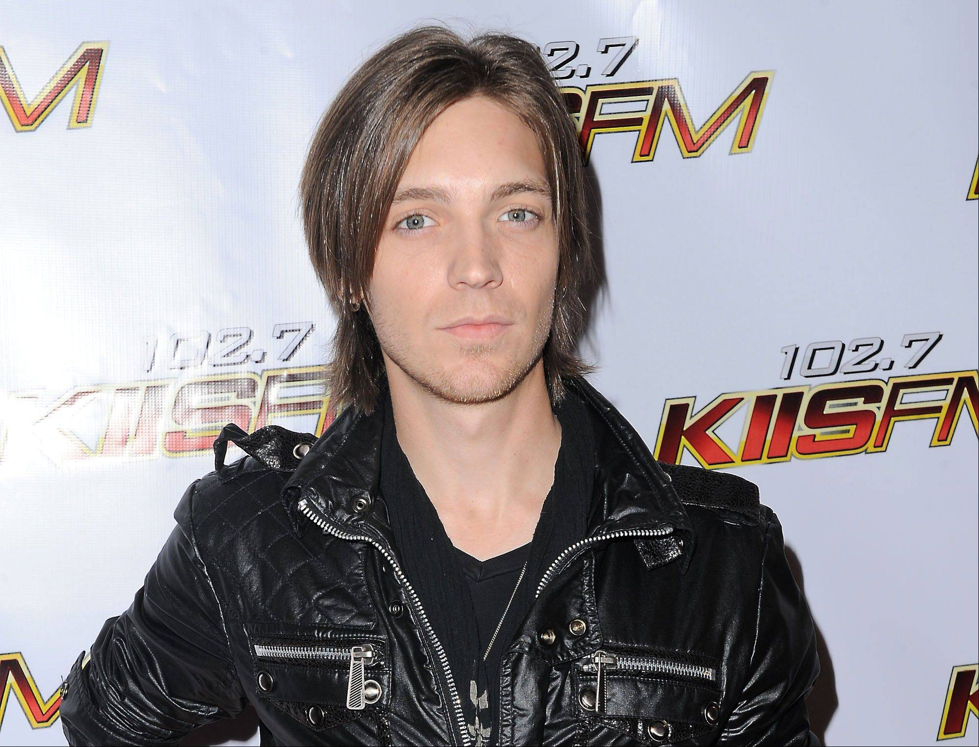 Alex Band, a member of the rock band The Calling, reports being abducted and robbed early Sunday after performing at a festival in Michigan.