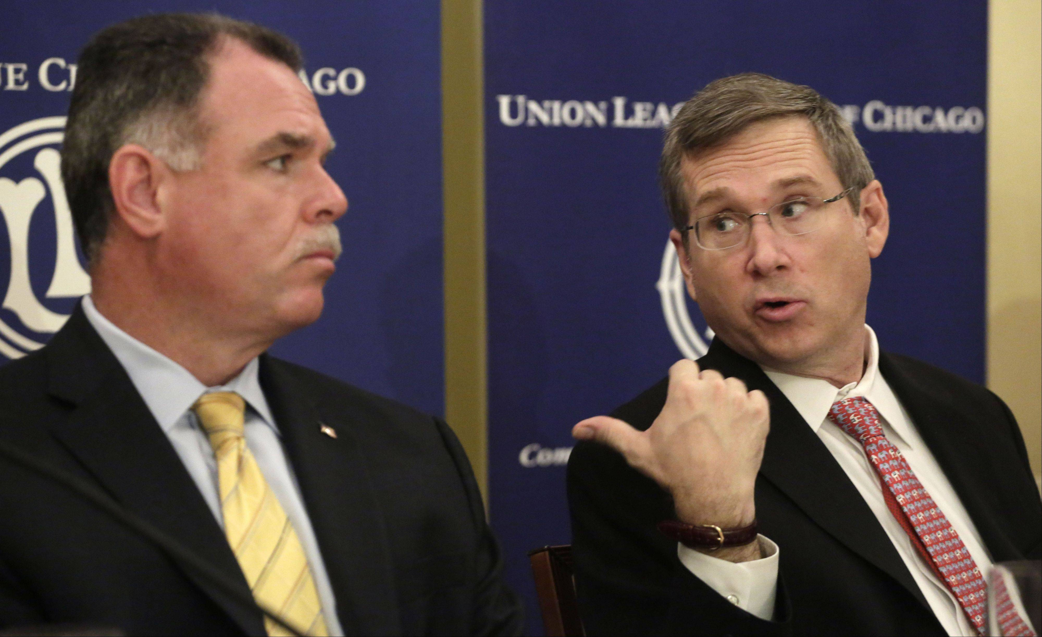 U.S. Sen. Mark Kirk, right, speaks to Chicago Police Superintendent Garry McCarthy as he highlights his anti-gang legislation at a news conference Monday in Chicago.