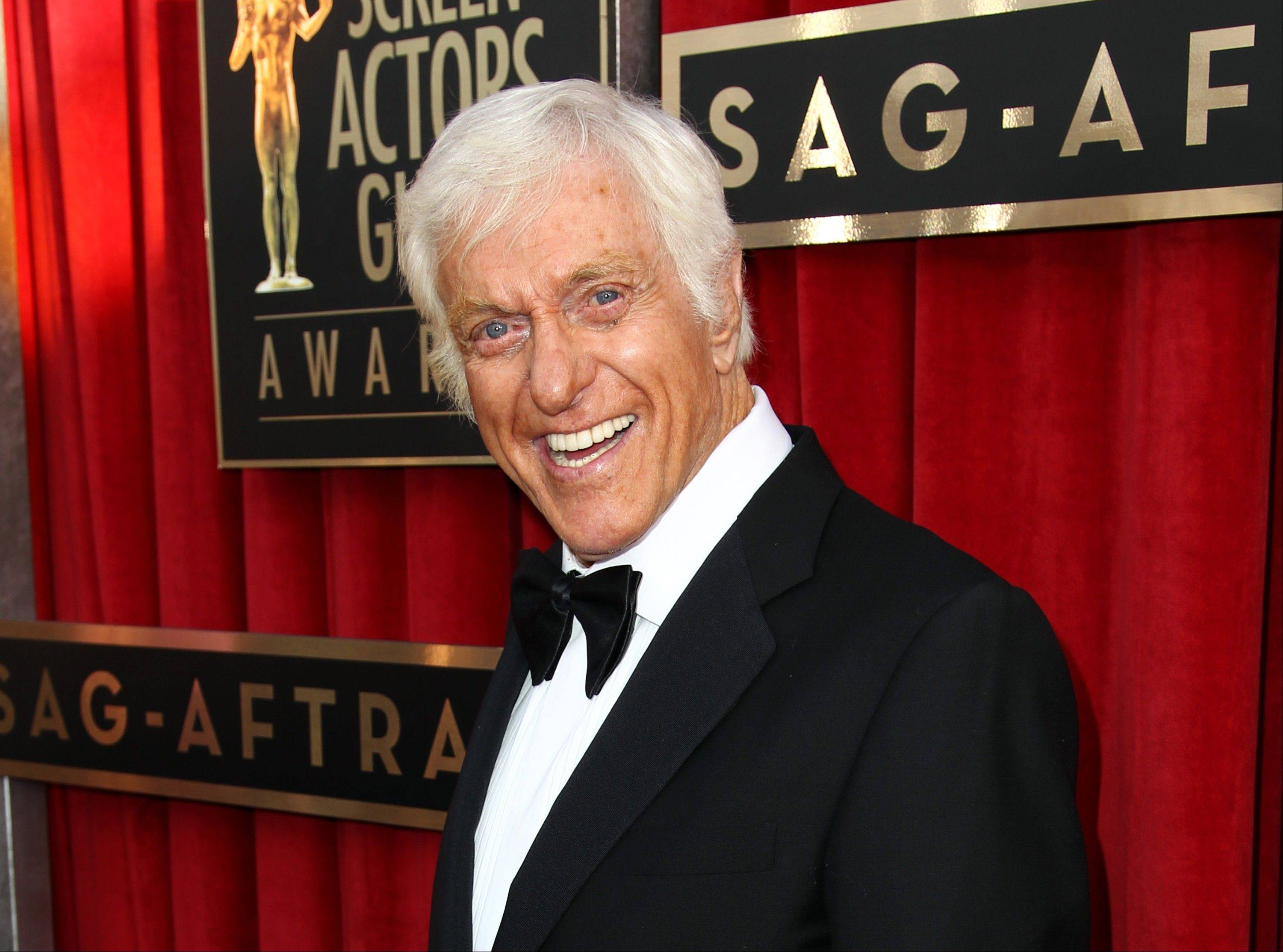 This Jan. 27, 2013, photo shows actor Dick Van Dyke at the 19th Annual Screen Actors Guild Awards at the Shrine Auditorium in Los Angeles. Van Dyke is fine after his Jaguar caught fire Monday while he was driving on a Los Angeles freeway.