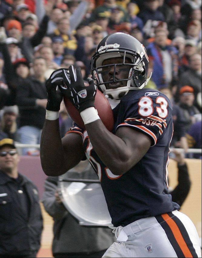 David Terrell catches a touchdown pass in 2004. He's been charged with manufacture or delivery of 30-500 grams of cannabis and with battery.