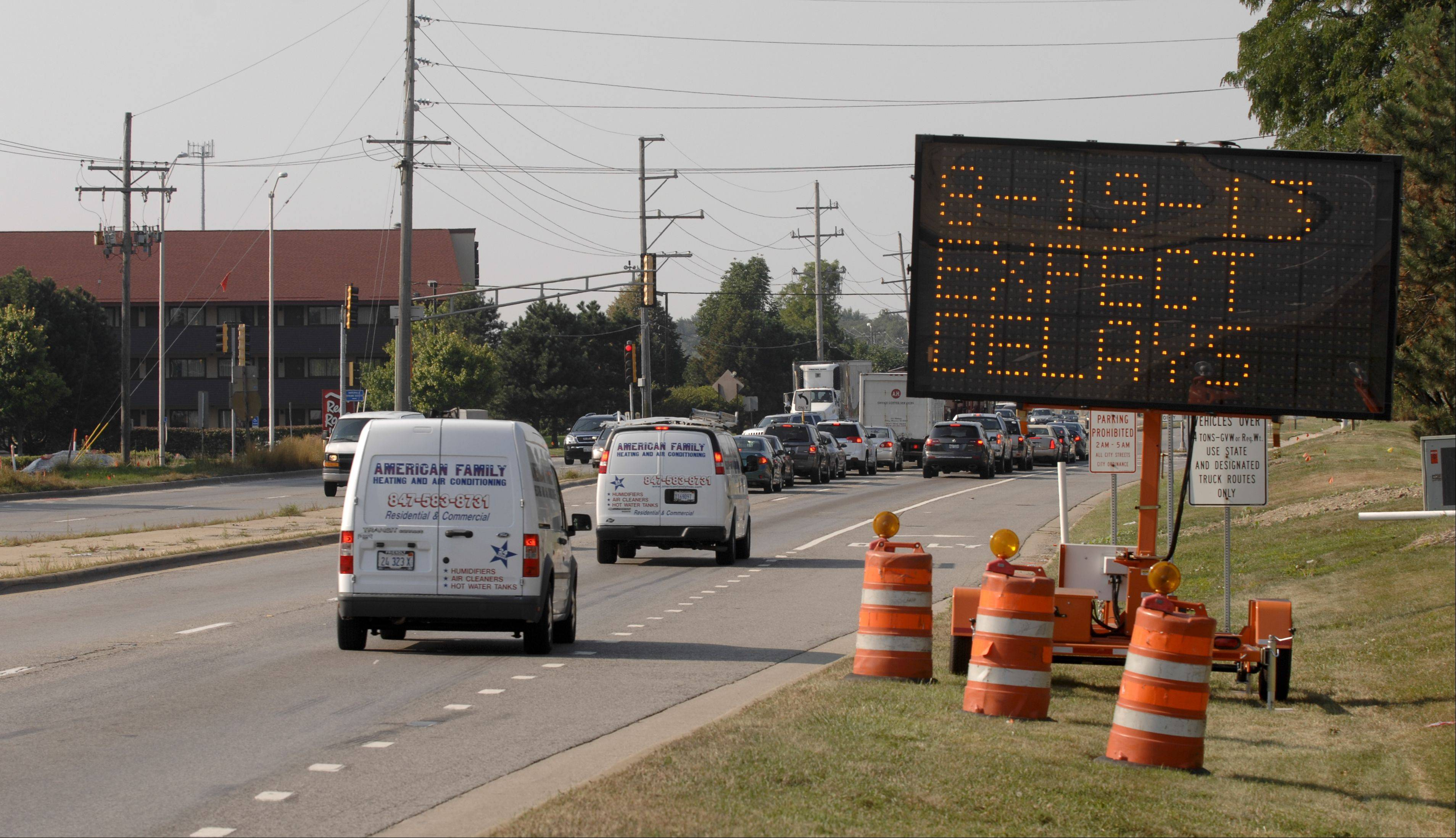 A sign warns drivers about construction that started Monday along Route 59 from Ferry Road south to Aurora Avenue/New York Street in Naperville. Crews first will be relocating utilities and setting up barricades to prepare for the two-year widening project.