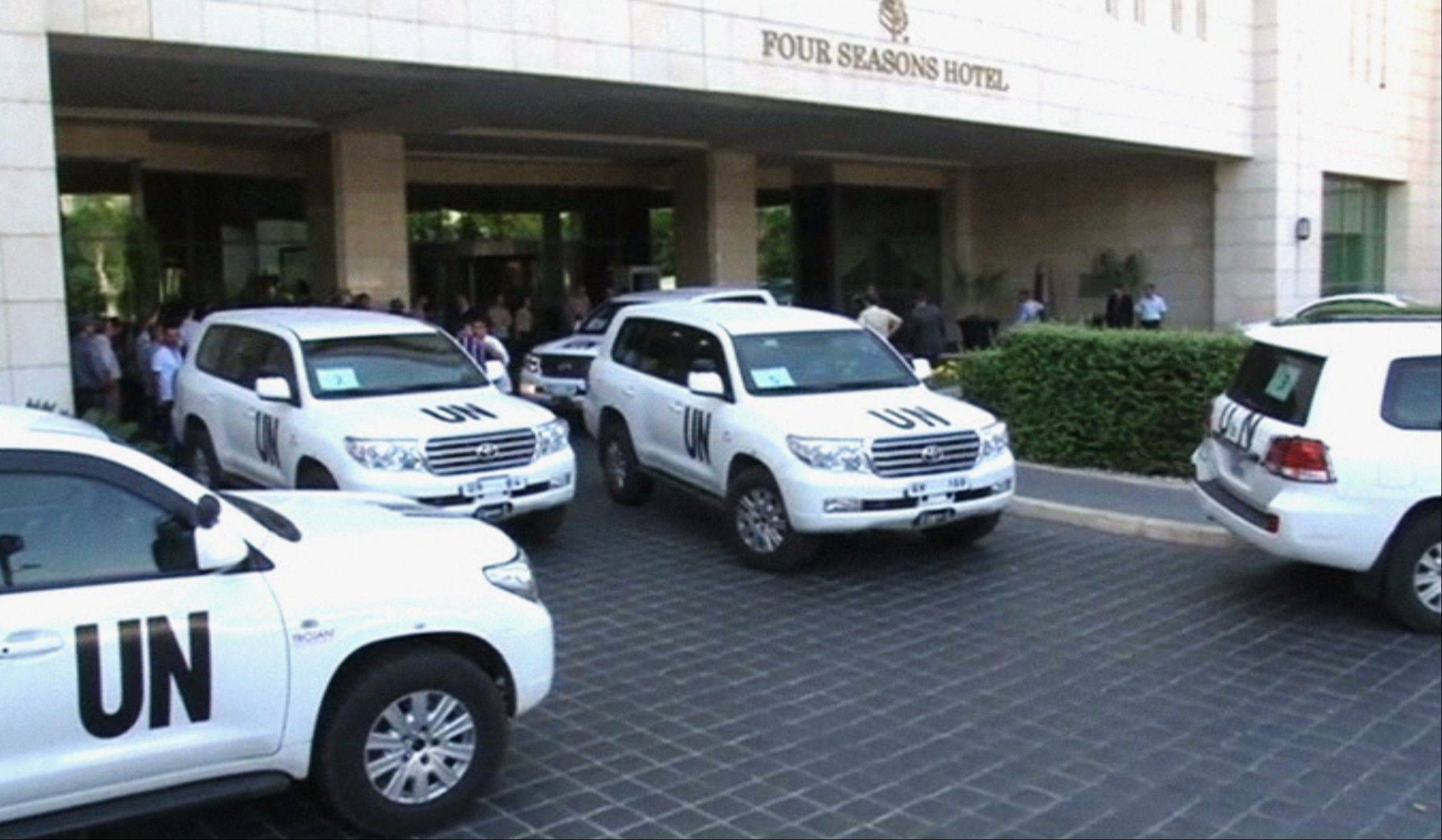 In this image made from video, U.N. vehicles leave the entry area of a hotel Sunday after U.N. weapon inspectors get off their vehicles upon their arrival in Damascus, Syria. A team of U.N. weapons inspectors arrived in Damascus on Sunday for a long-delayed mission to investigate the alleged use of chemical arms in Syria's civil war.