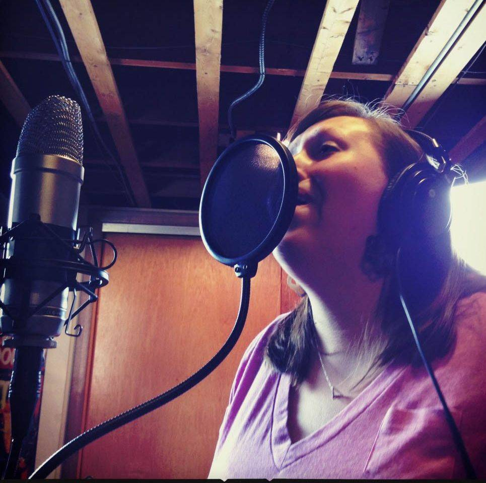 "Heidi Malcolm of Restoration Project records vocals for ""God Is So Good,"" one of five songs on the first EP in the hymn-writing collective's newest effort, ""Firm Foundation."""