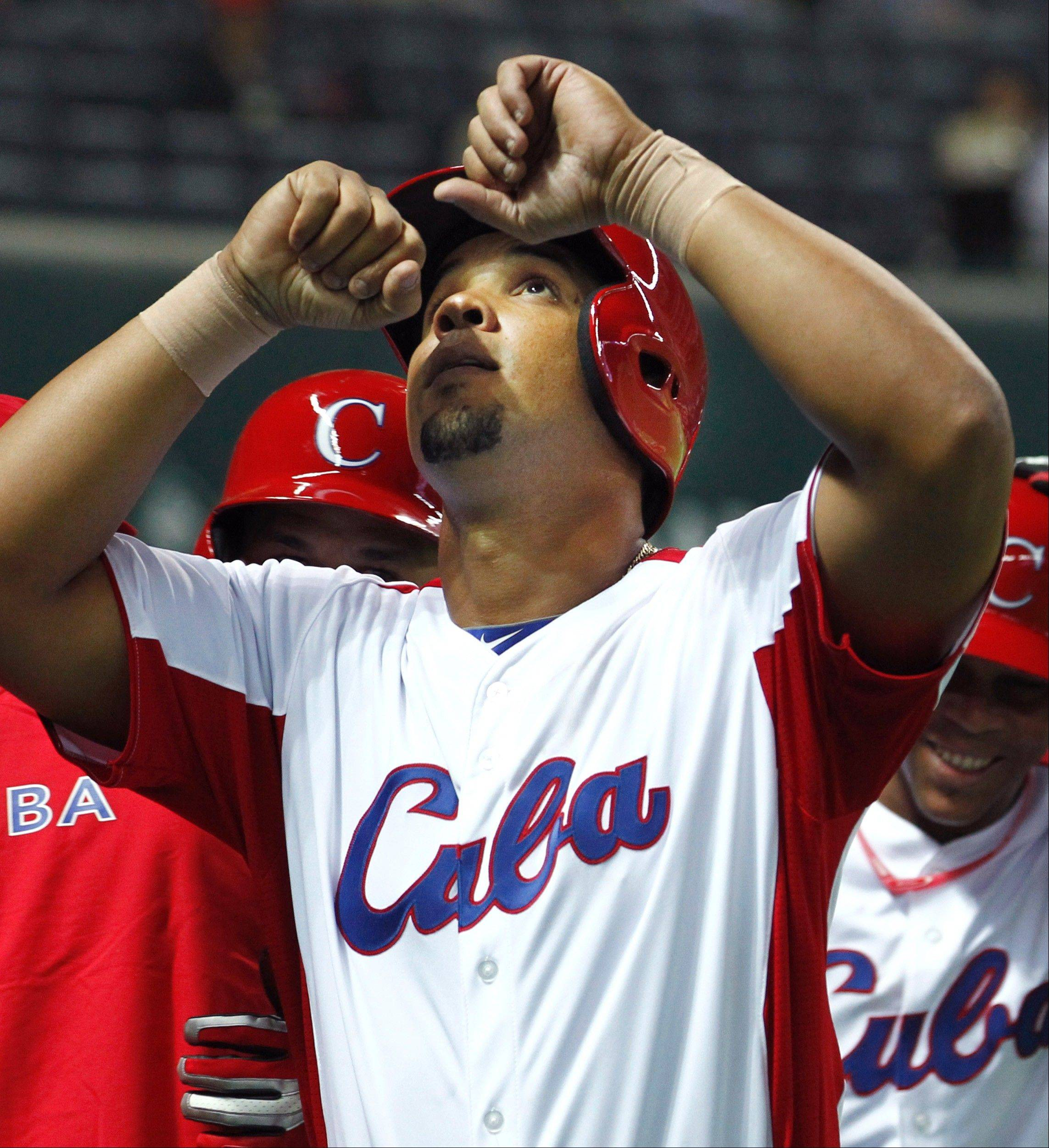 Cuba's first baseman Jose Abreu reacts after hitting a grand slam off China's Liu Yu in the fifth inning of their World Baseball Classic first round game in Fukuoka, Japan, Monday, March 4, 2013.