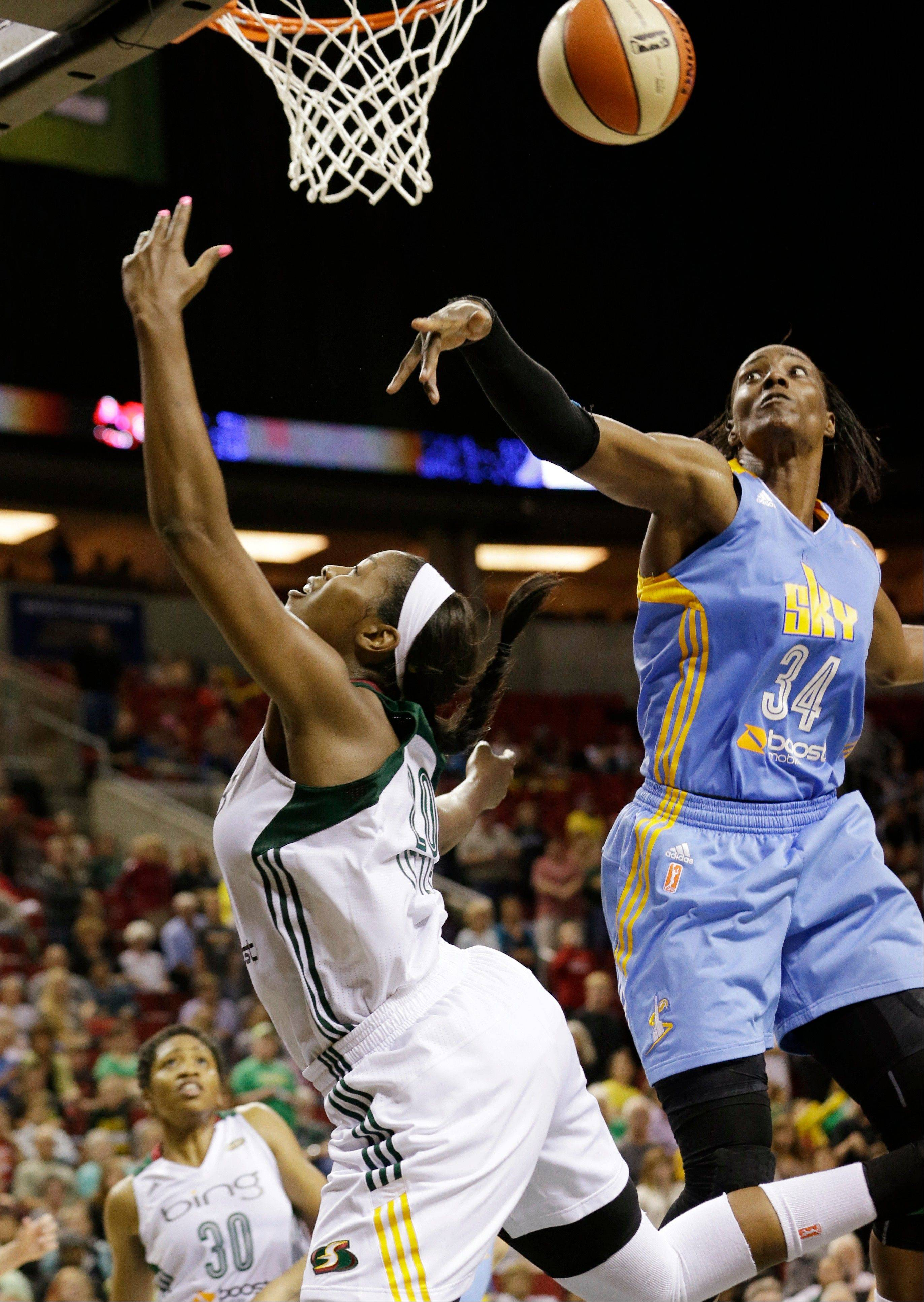 The Sky's Sylvia Fowles, right, knocks away a shot attempt by Seattle Storm's Camille Little late in the second half of game Thursday in Seattle. The Sky won 79-66.
