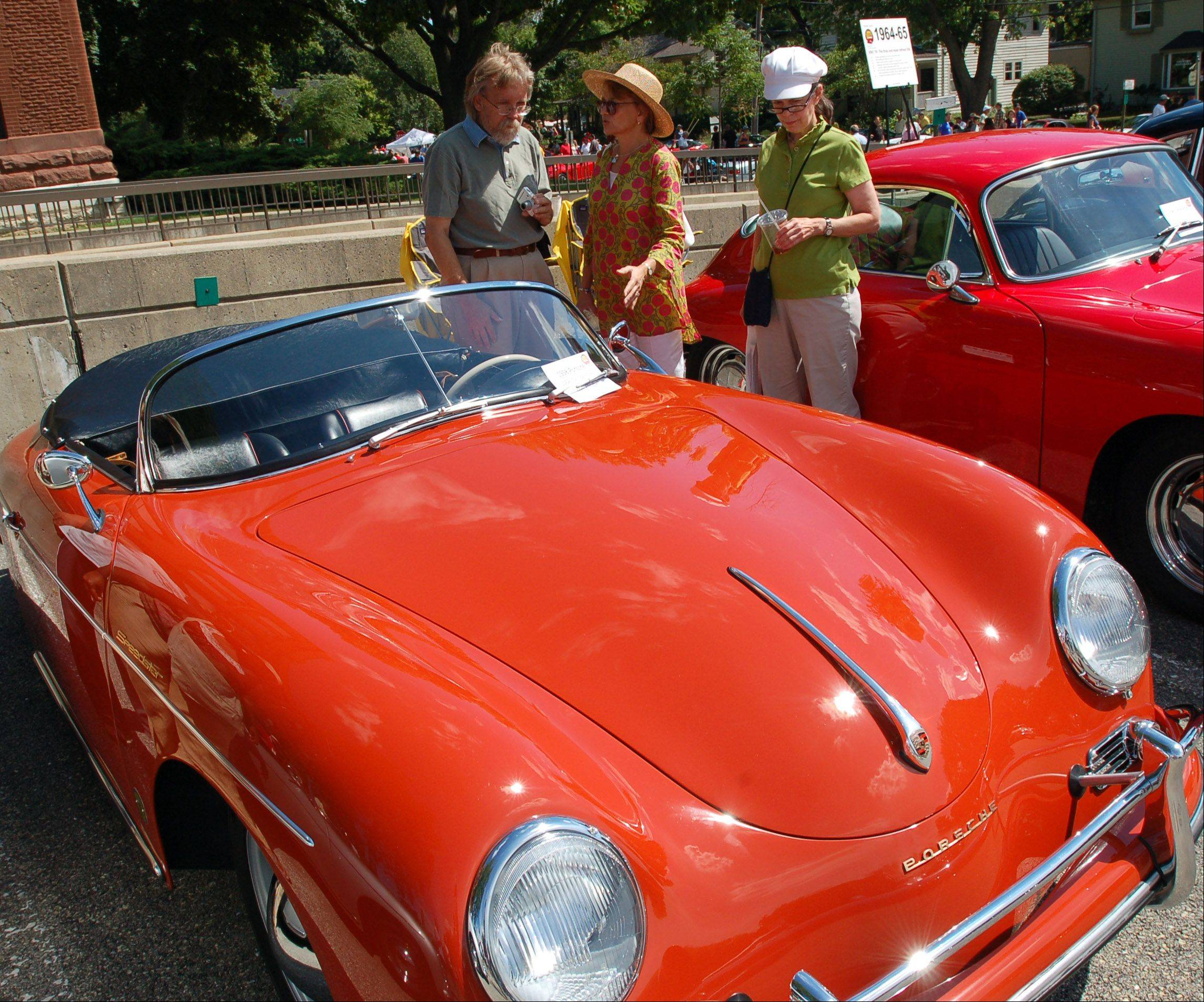 From left, Tom Drebenstedt of Chicago, Chris Aupperle of Rockford and Kathy Chilis of Chicago check out a 1958 Porsche 356A (T2) Speedster owned by Tom Kingbell during a previous Geneva Concours d'Elegance classic car show. This year's show is on Sunday, Aug. 25 in downtown Geneva.