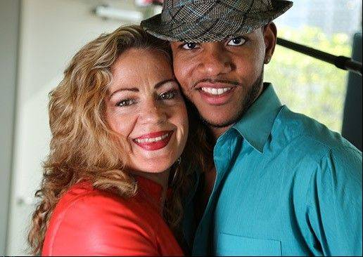 "Sheri Winkelmann, 50, poses with her fiance, Desmond Huey, 26. The couple will be featured on the TLC reality TV series ""Extreme Cougar Wives."""