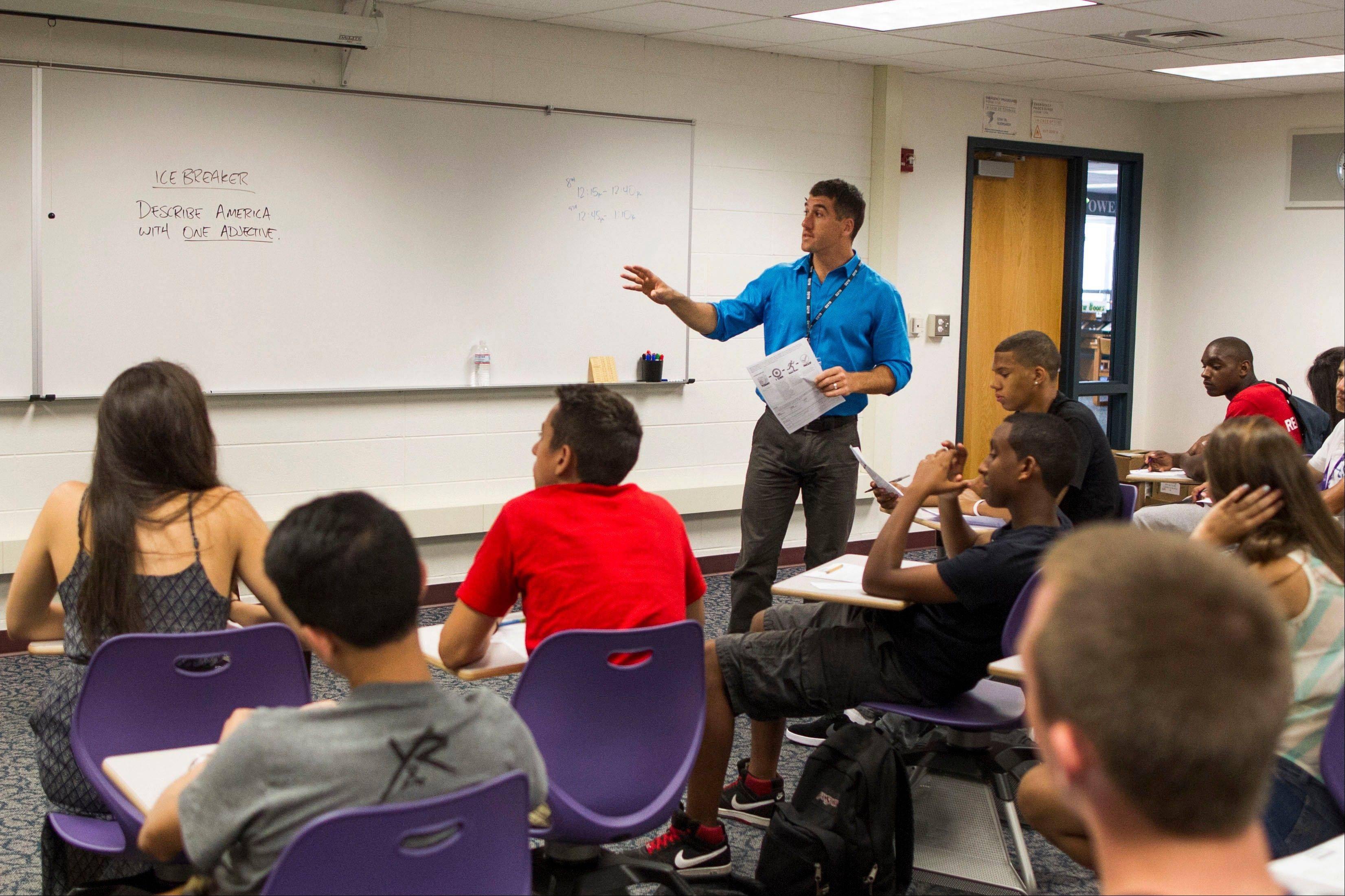 Ivan Silverberg teaches his American studies class Tuesday at Niles North High School in Skokie. This is the first school year that 34 Illinois districts beyond Chicago will begin grading teachers on whether their students� test scores are improving.