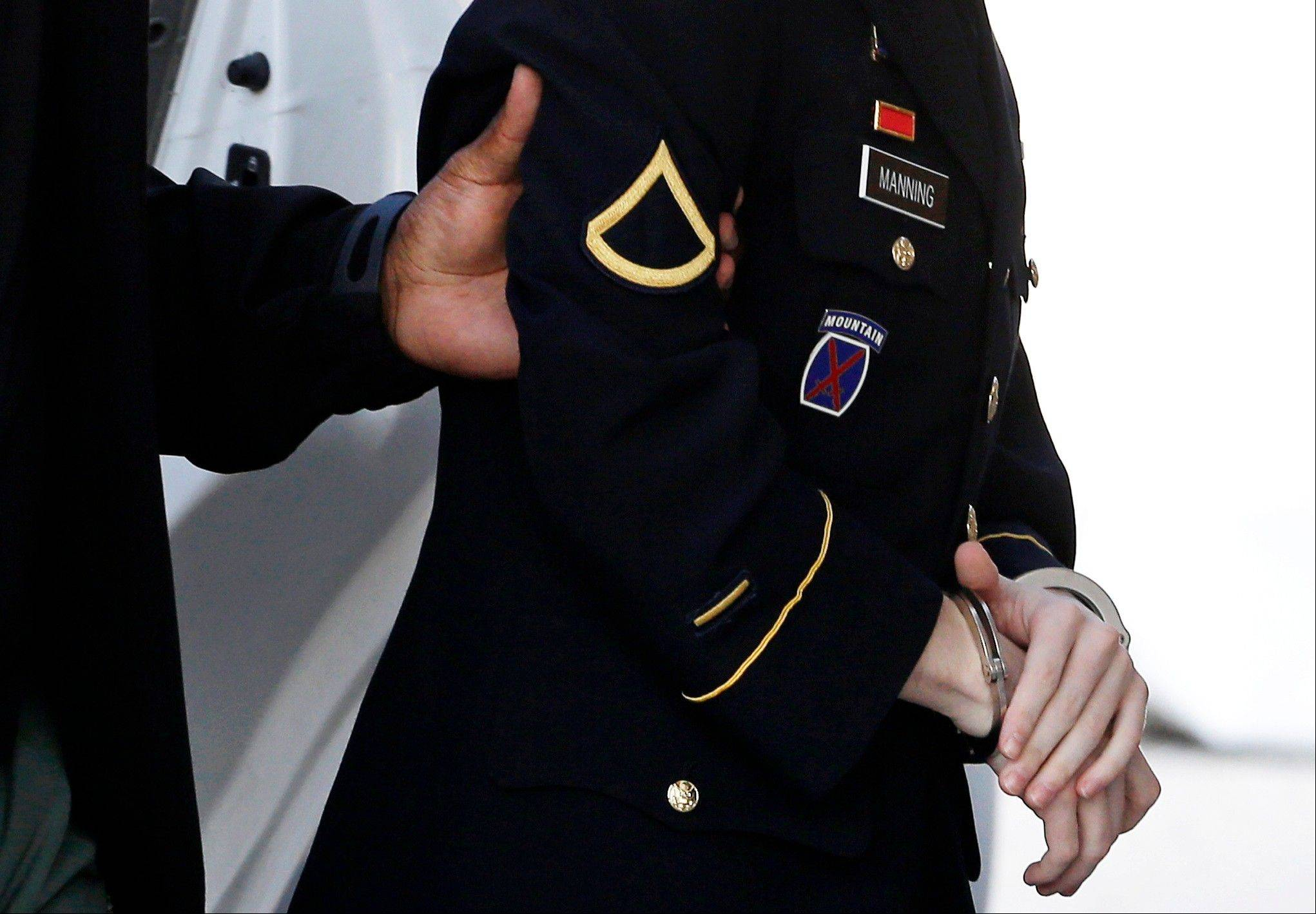 Army Pfc. Bradley Manning is escorted into a courthouse in Fort Meade, Md., Tuesday, Aug. 20, 2013, before a hearing in his court martial. A military judge began deliberating Army Pfc. Bradley Manning�s sentence Tuesday for disclosing reams of classified information through WikiLeaks.