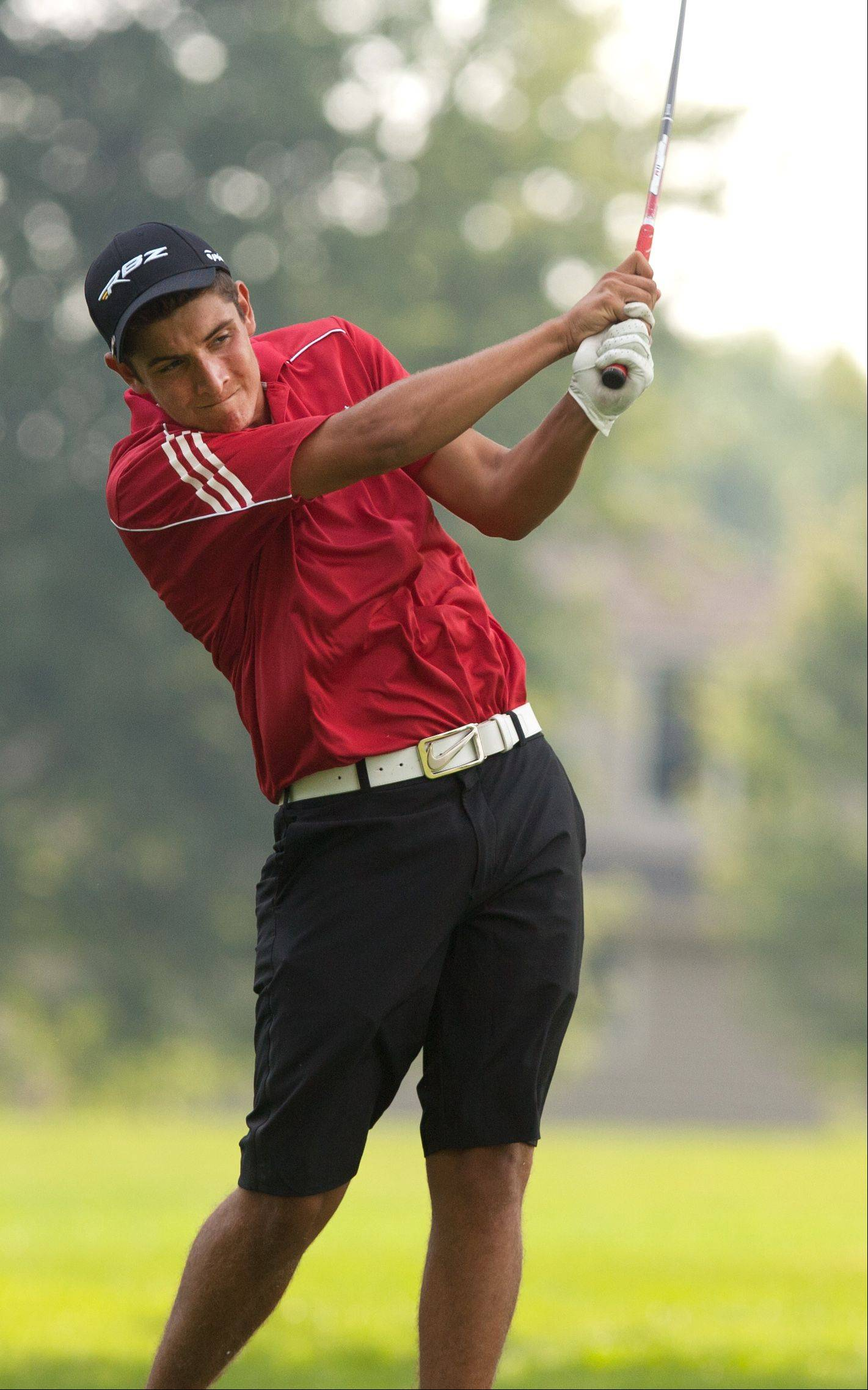 Alex Bassetto of Benet tees off during the 2013 Vern McGonagle Memorial boys and girls golf invitational at the Naperville Country Club.