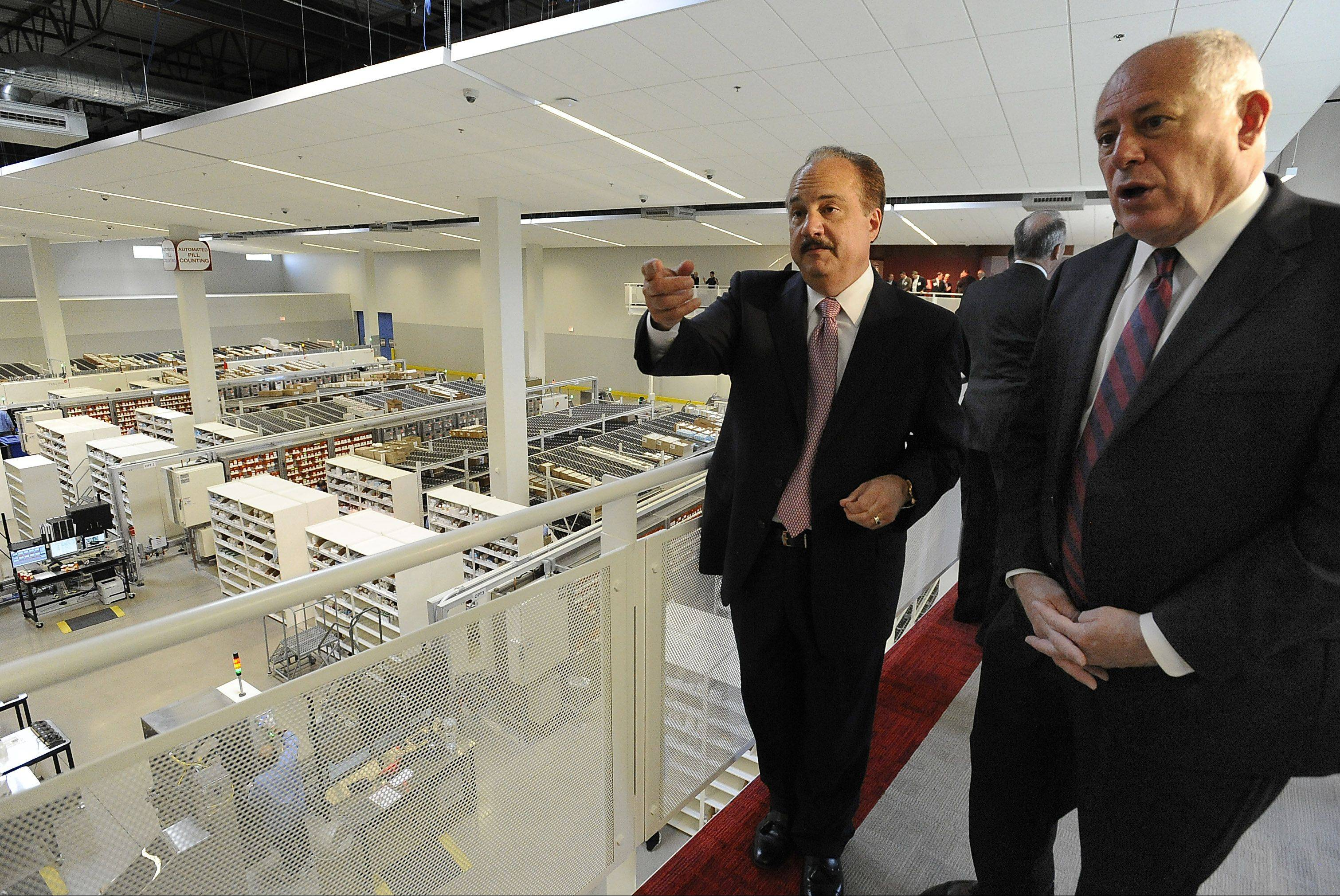 Gov. Pat Quinn, right, and Larry Merlo, CEO and president of CVS Caremark, toured the new CVS Caremark Mail Service Pharmacy and Customer Center in Mount Prospect on Tuesday.