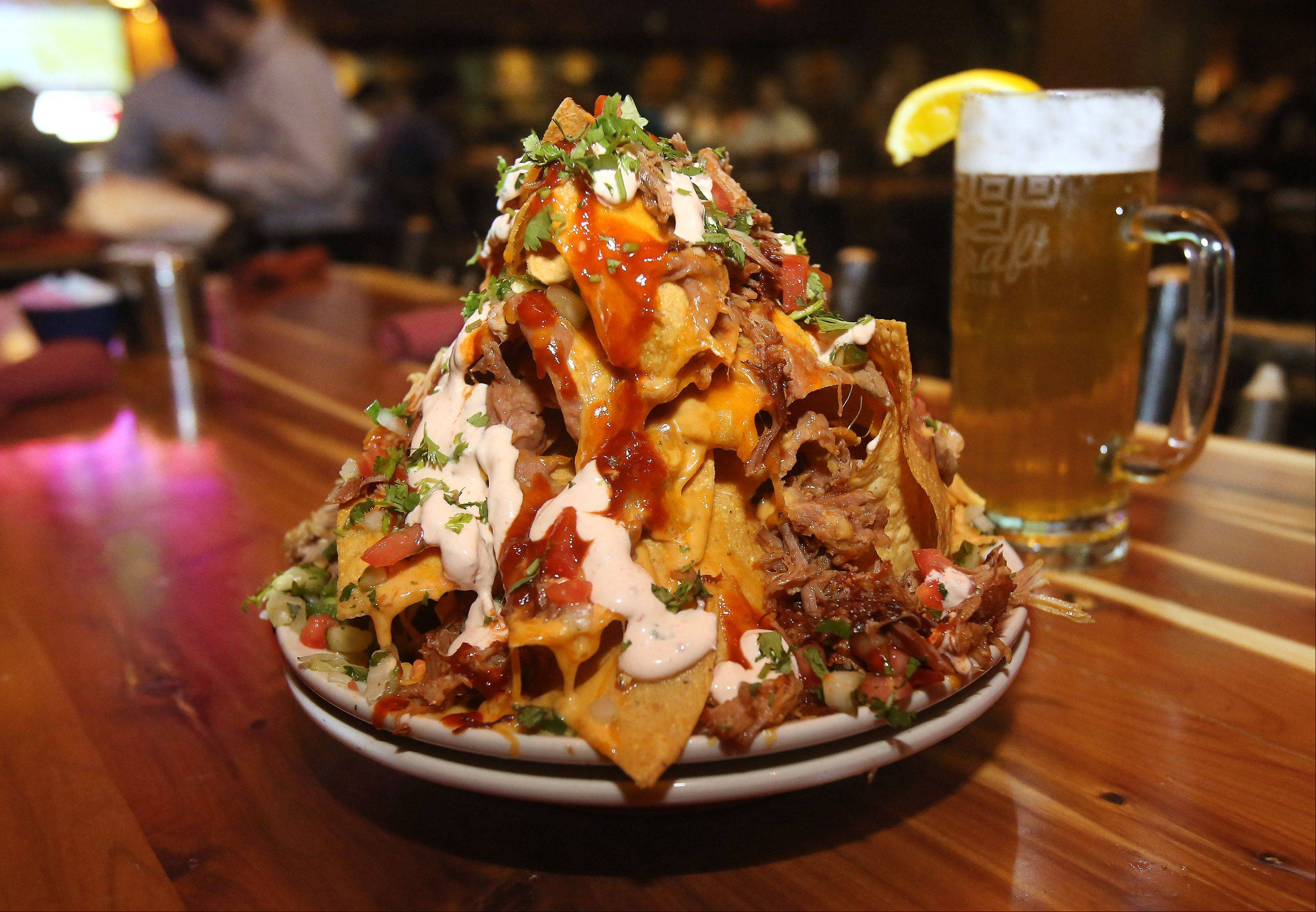 The BBQ Pulled Pork Nachos provide a mountain of a snack at Twin Peaks in Wheeling.