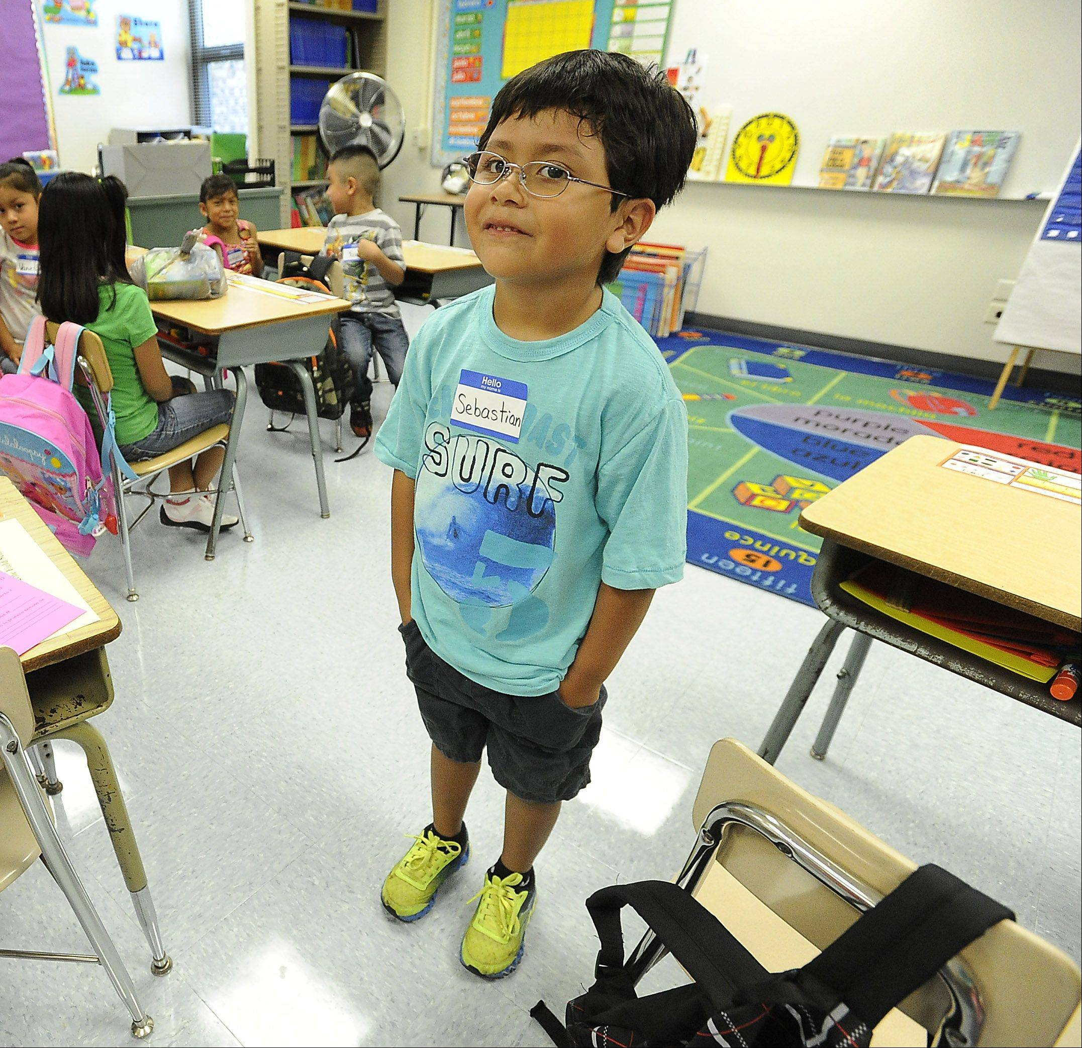 Sebastian Castillo celebrates his birthday on the first day back in the first grade at Field Elementary School in Wheeling on Wednesday.