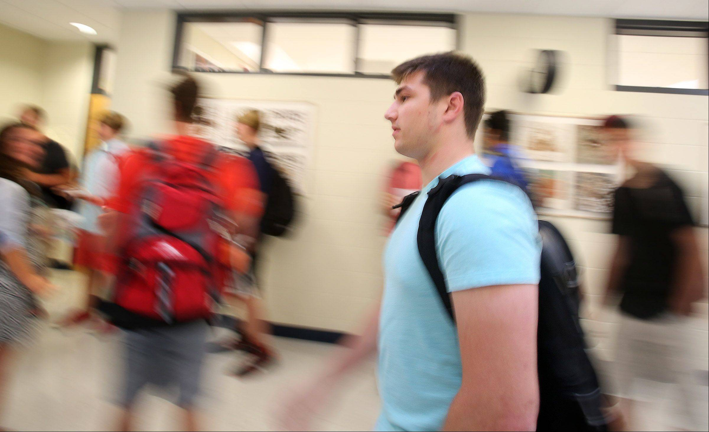 Sam Torrence rushes to his first class after the morning bell Tuesday, the first day of school at Barrington High School.