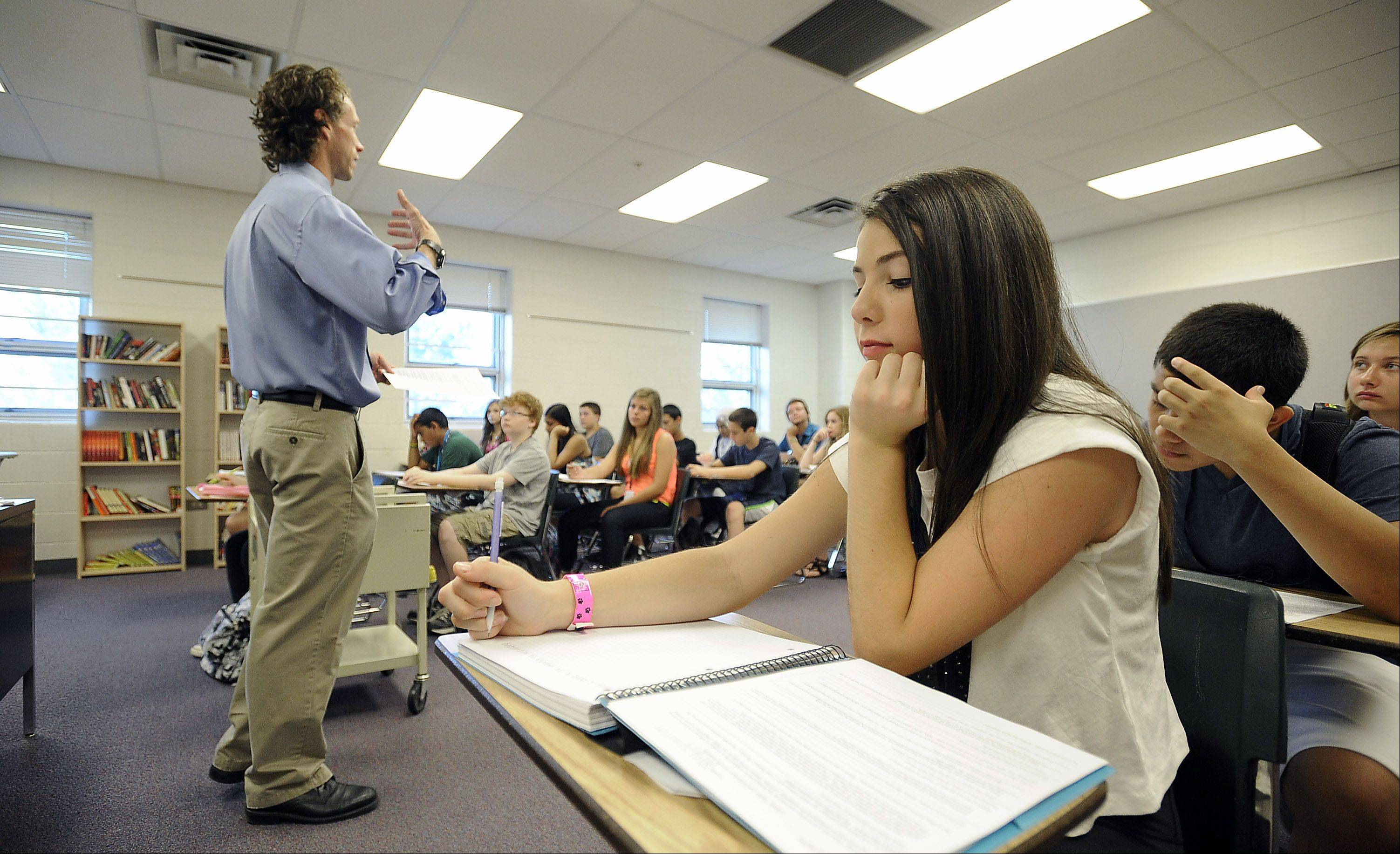 Freshman Kelly Schmieder, 14, sits in her freshman honors English class as teacher Jeff Horler tells them about the book Moby Dick on the first day back to school at Bartlett High School.