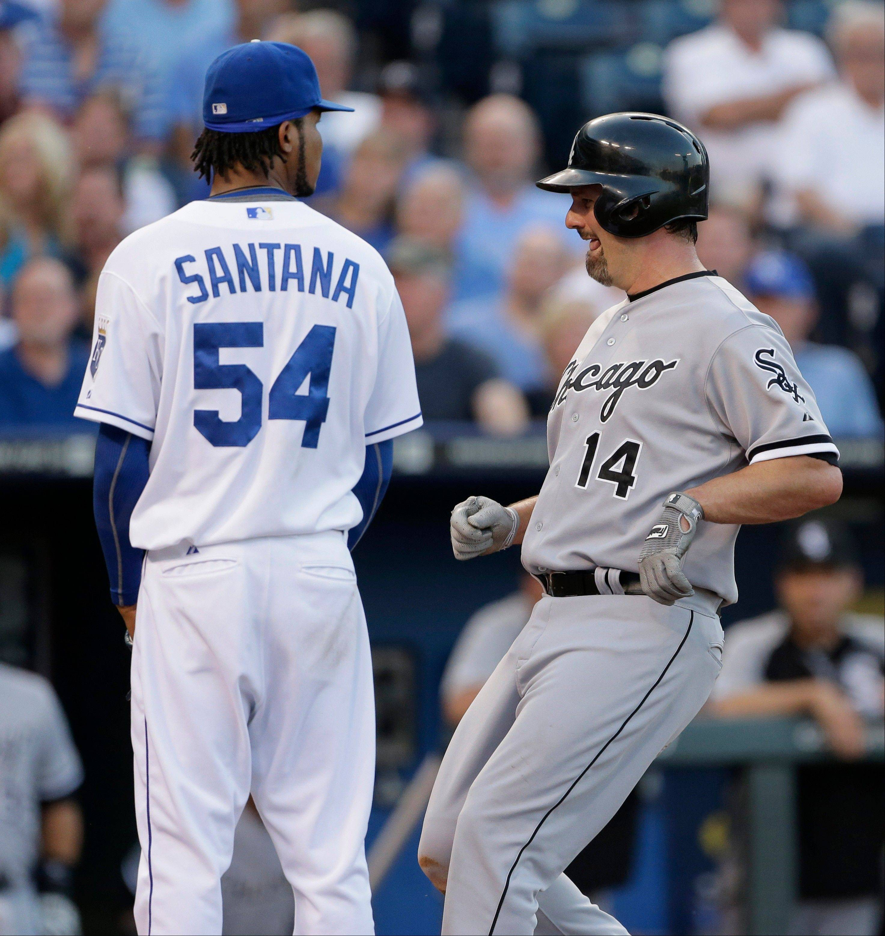 Paul Konerko runs past Royals starting pitcher Ervin Santana as he scores on a passed ball during Tuesday night's 2-0 White Sox victory.