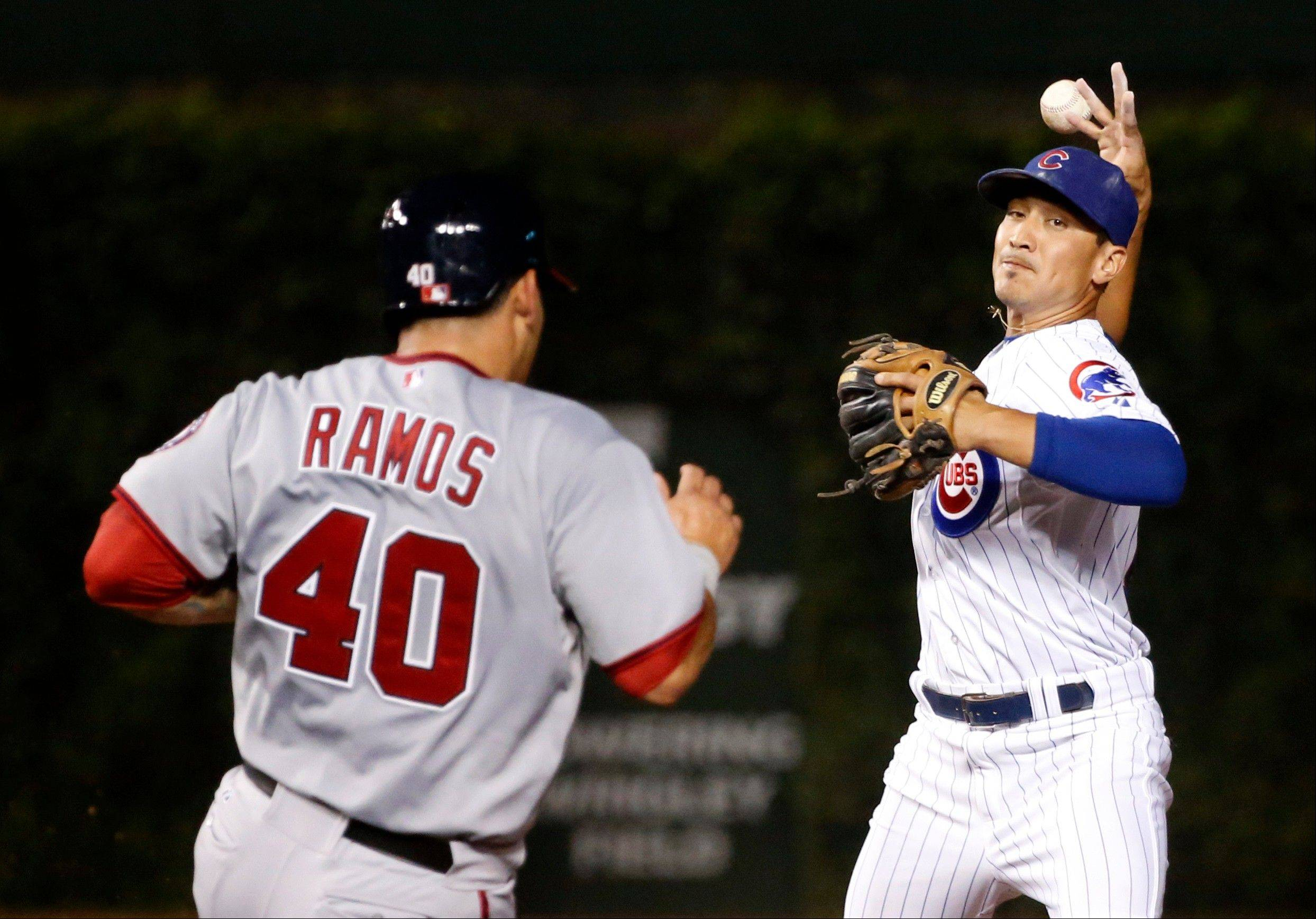 Cubs second baseman Darwin Barney loses his grip on the ball after forcing out the Nationals' Wilson Ramos at second on Tuesday during the fourth inning in Chicago.