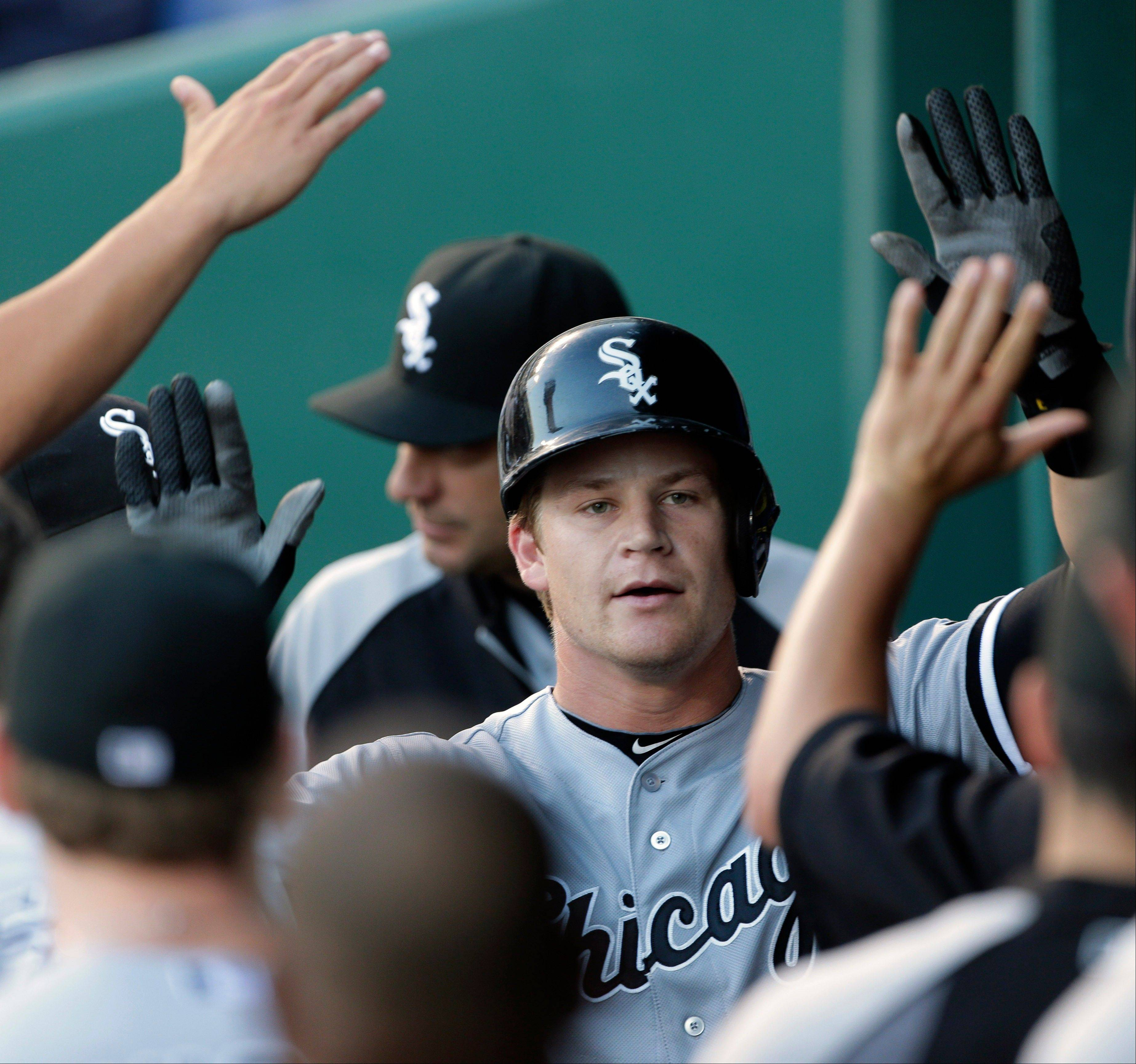 Gordon Beckham is congratulated in the White Sox dugout after hitting a solo home run during the first inning Tuesday in Kansas City, Mo.