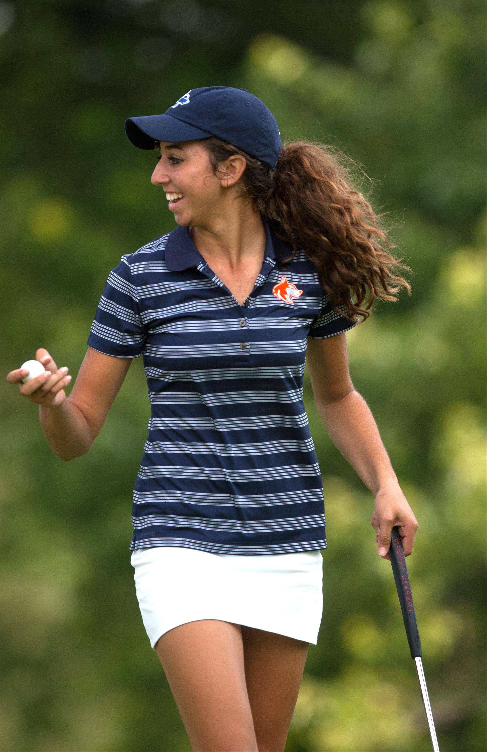 Taylor Arenson of Naperville North reacts to her putt, during the 2013 Vern McGonagle Memorial boys and girls golf invitational at the Naperville Country Club.