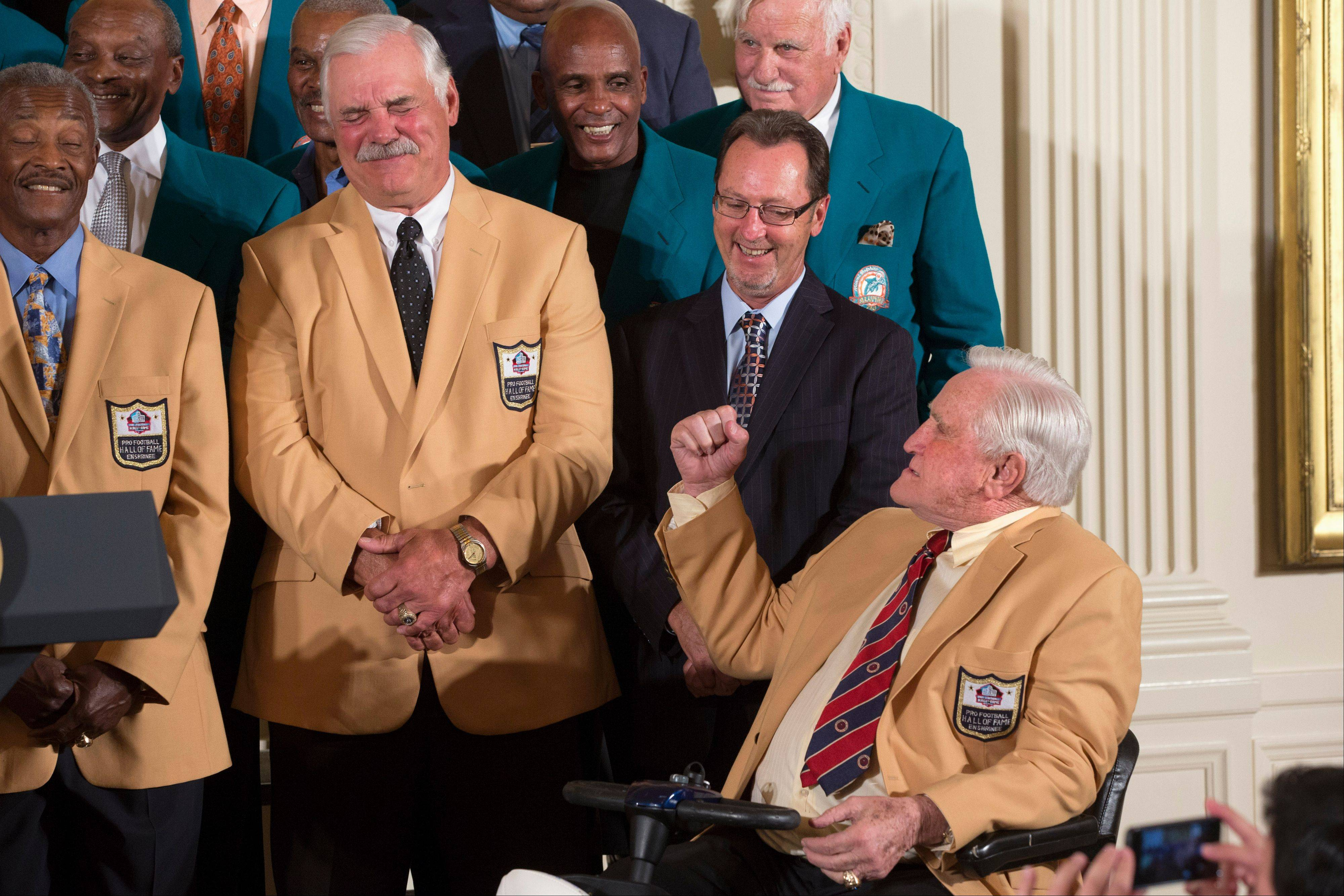 Former Miami Dolphins fullback Larry Csonka, second from left, grimaces as Hall of Fame coach Don Shula jokingly shakes a fist at him Tuesday during a ceremony in the East Room of the White House.