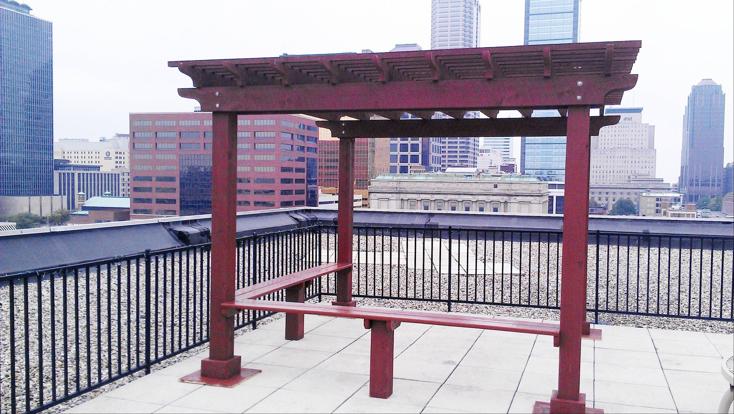 The rooftop pergola built from a Quality Built Backyards kit was installed in the city.