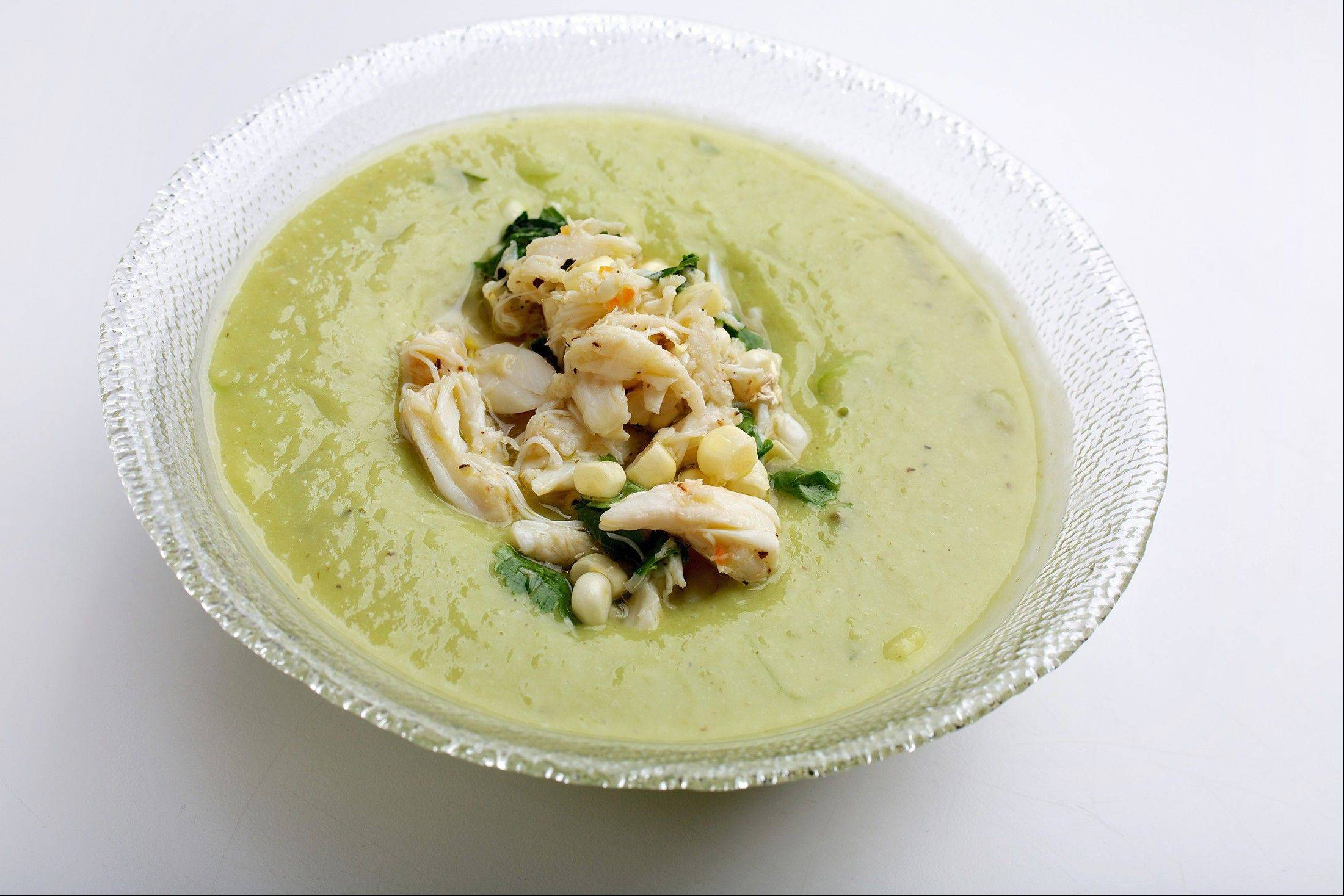 The soothing richness of Chilled Avocado and Melon Soup is perked up by the heat and acidity of the marinated crab and corn salad.