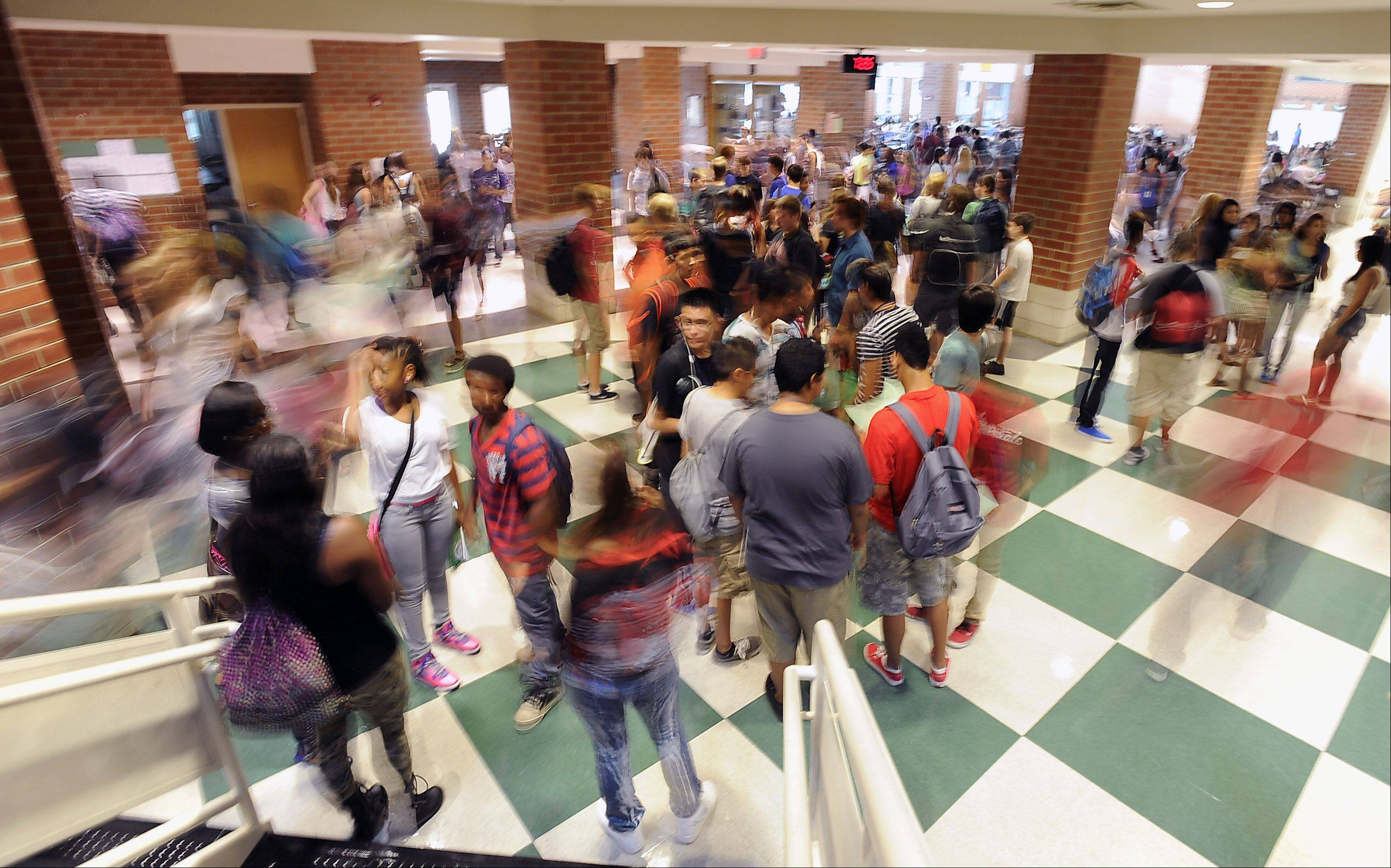 Students at Bartlett High School hurry to their classes on this first day back to school on Monday.