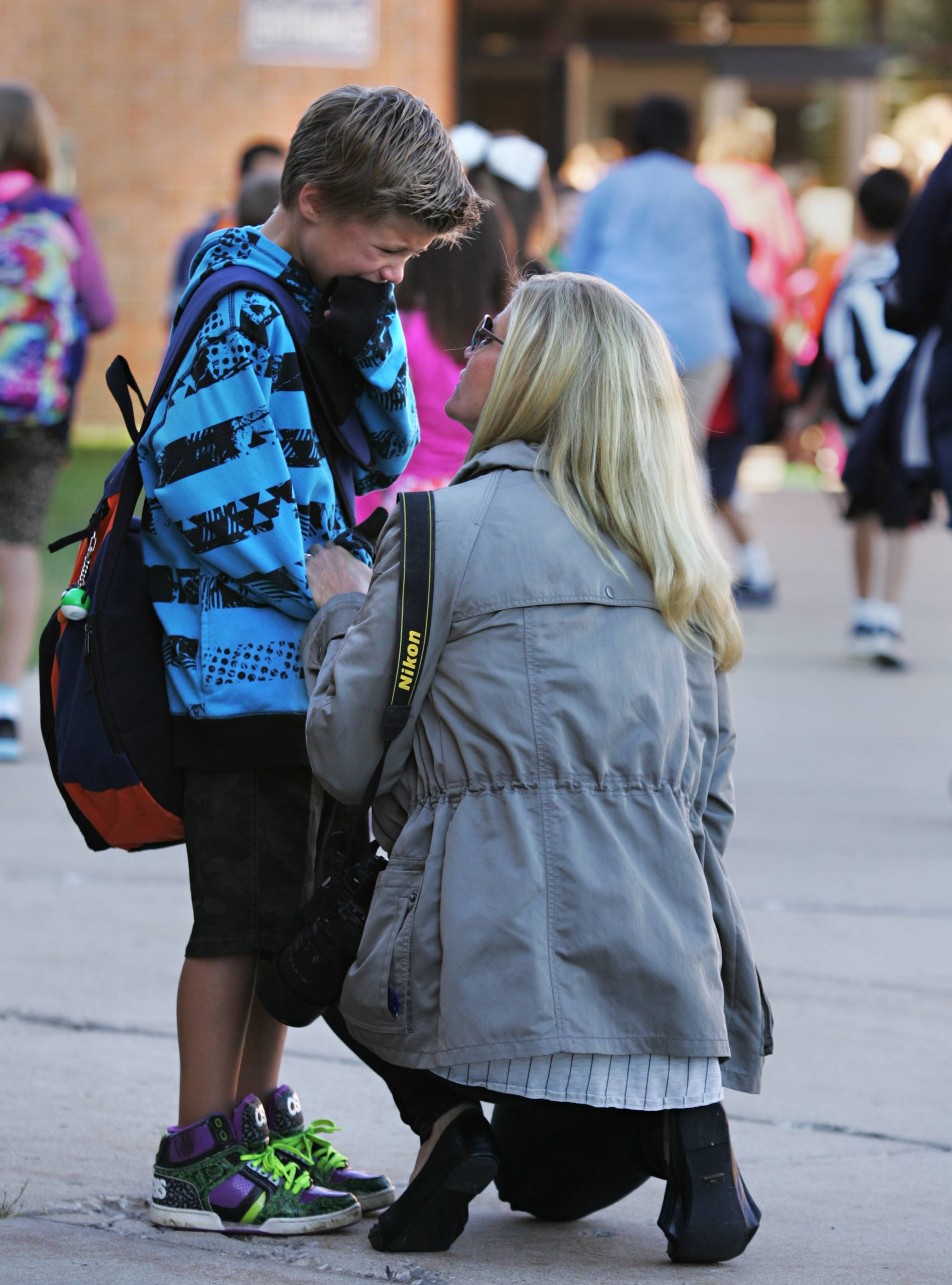 Second-grader Brennan Sproule is consoled by his mother Tricia Wednesday morning before the first day of class at Westfield Community School, where Brennan is attending class for the first time. The Sproules moved to a different neighborhood in Algonquin over the summer, so Brennan wasn't sure about the new building, his new teacher and all new classmates.