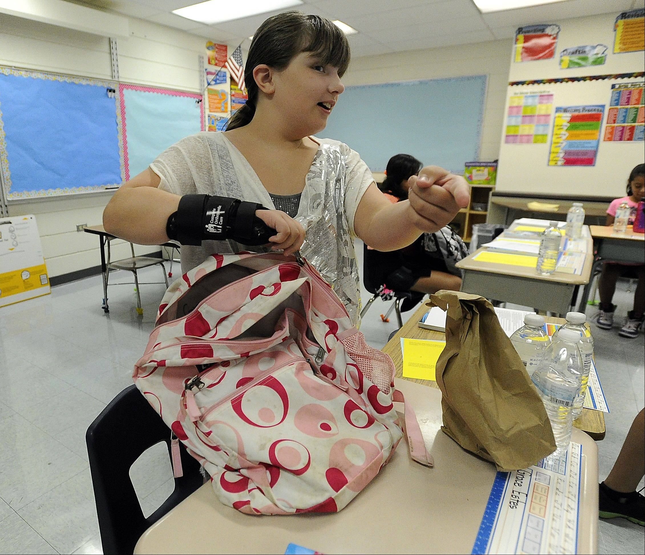 Grace Estes, 9, unpacks her school supplies on her first day back to school at Field Elementary School.