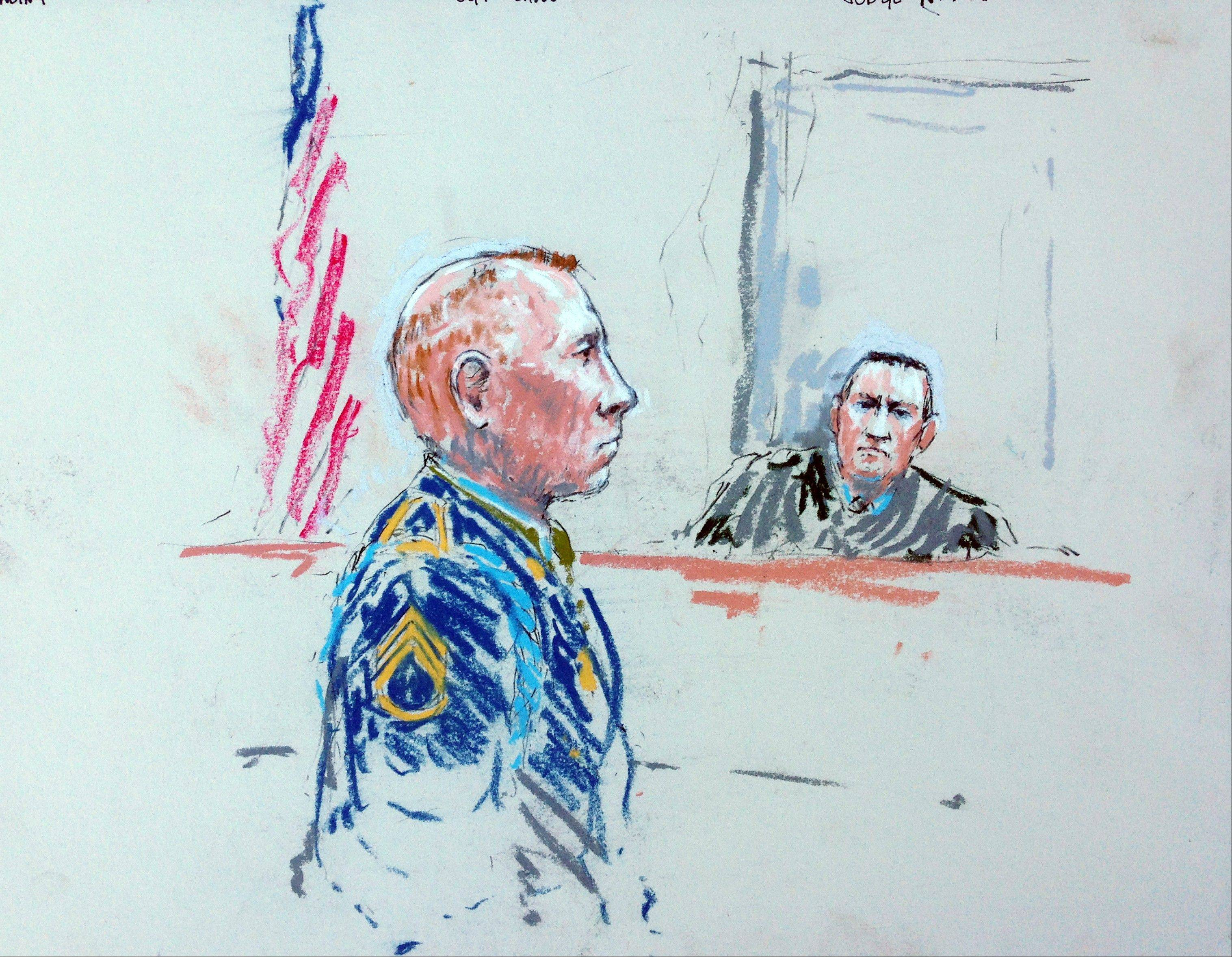 In this courtroom sketch, Staff Sgt. Robert Bales, left, appears Tuesday before Judge Col. Jeffery Nance in a courtroom at Joint Base Lewis-McChord, Wash., during a sentencing hearing in the slayings of 16 civilians killed during pre-dawn raids on two villages on March 11, 2012.
