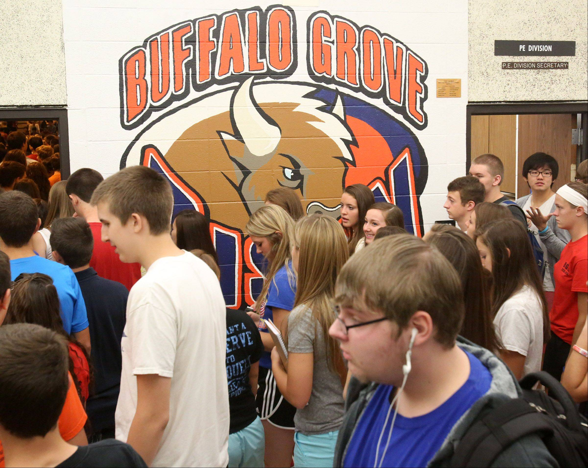 Students crowd the hallway during the first day at Buffalo Grove High School.
